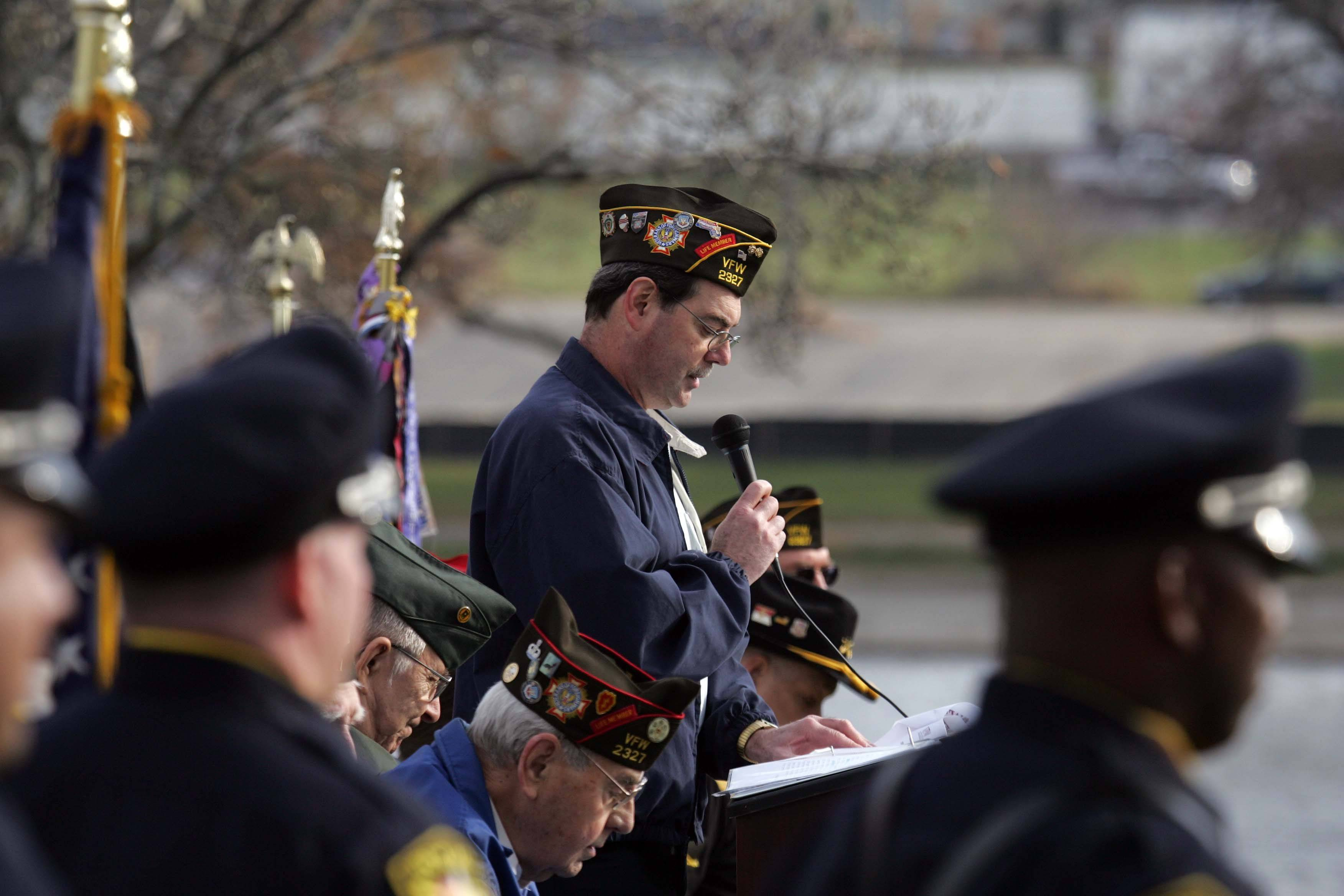 South Elgin VFH commander David Kozuch pauses during the Veterans Day service at Panton Mill Park in South Elgin Thursday.