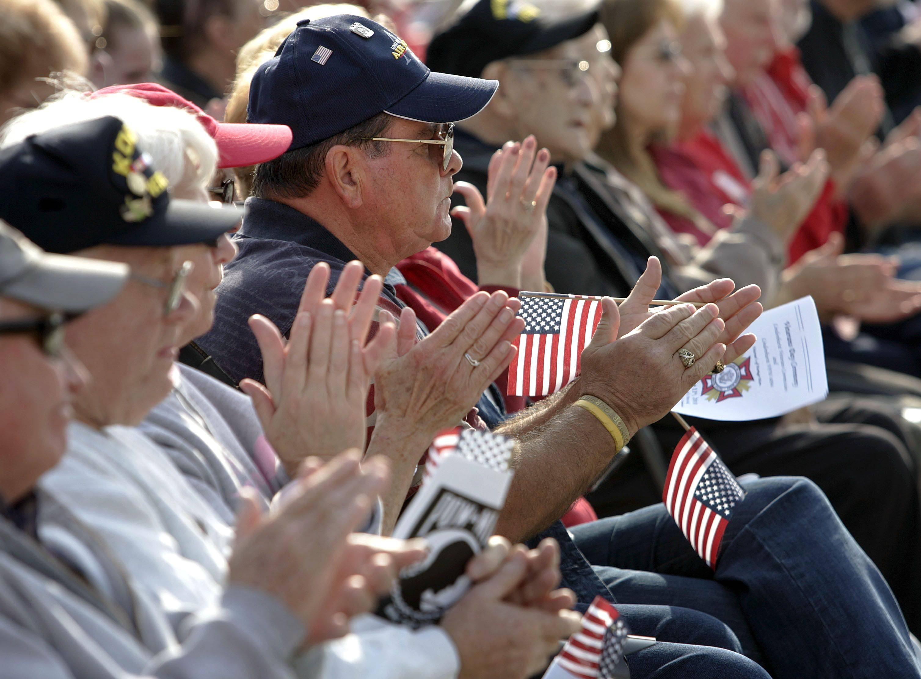 Veterans applaud during a Veterans Day ceremony at the Lindenhurst Veterans Memorial Thursday morning.