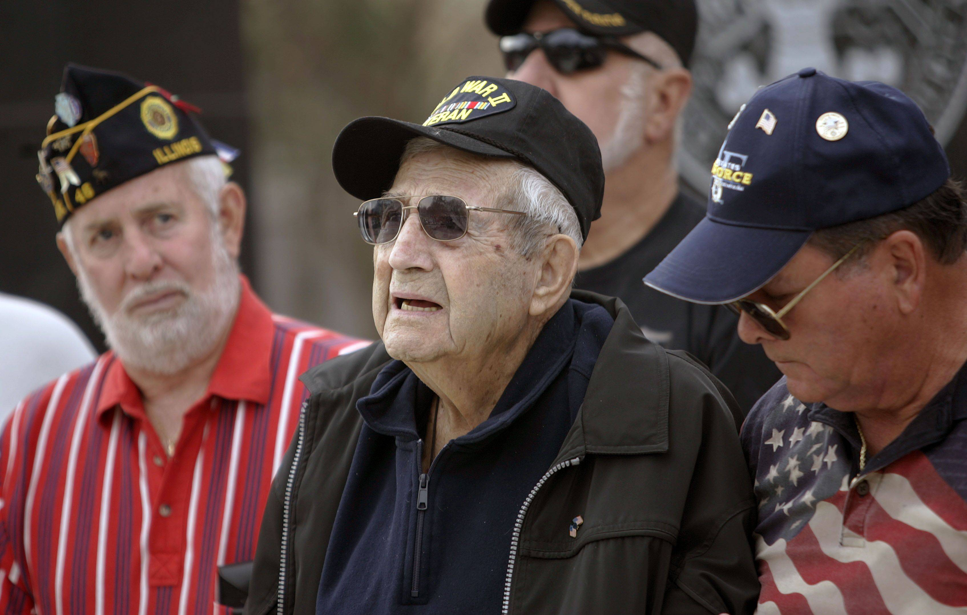 World War II Veteran Ed Bybee of Lindenhurst, center, flanked by Richard May of Lindenhurst, left and Lawrence Piemontese of Mundelein, all stand as local veterans were honored during a Veterans Day ceremony at the Lindenhurst Veterans Memorial Thursday morning.