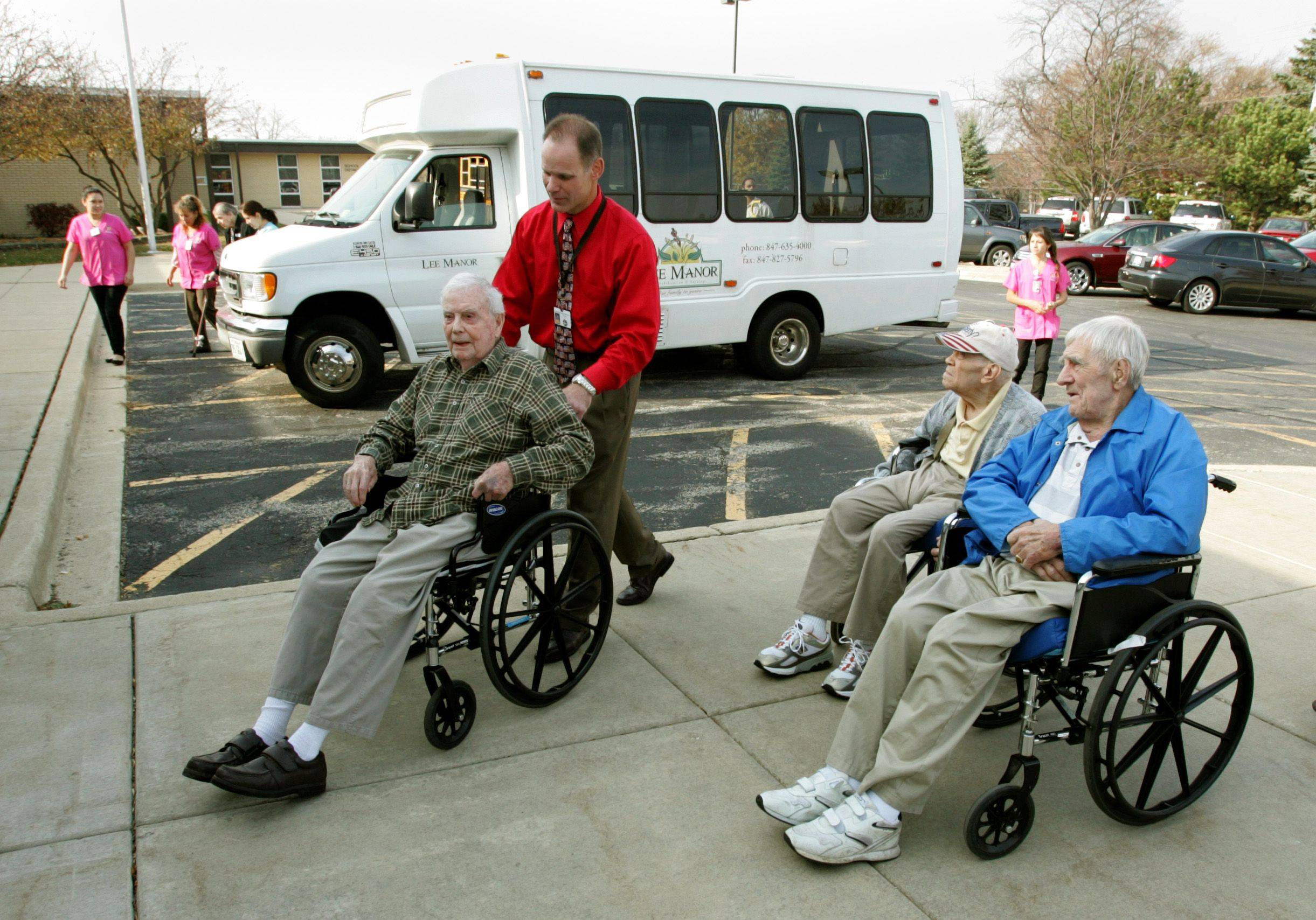 Principal Mark Dwyer of DuJardin Elementary School in Bloomingdale, wheels in World War II veterans from the Lee Manor Retirement home in Des Plaines, to participate in a Veterans lunch at the school.