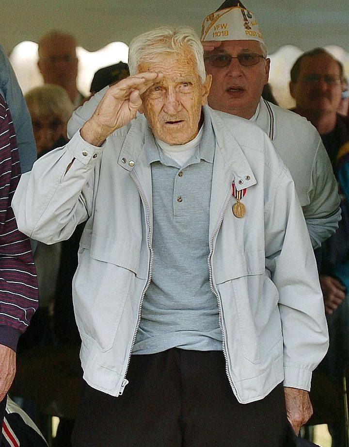 World War ll Merchant Marine veteran Nick DeBrown of Bartlett, salutes the flag during Veterans Memorial Site dedication in Bartlett.