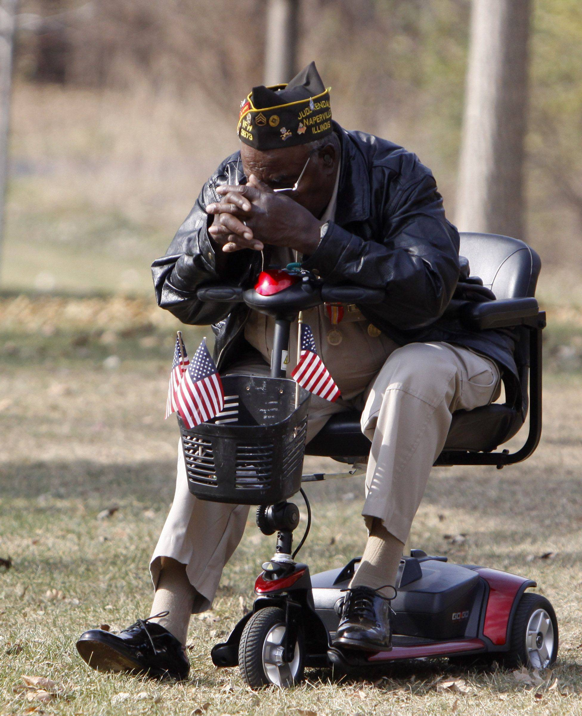 Colin Spiller of Naperville stood back from the crowd Thursday at Naperville's observance of Veterans Day at Veterans Park in Naperville. Spiller was a Staff Sergeant in the Army and was deployed on a 14 month tour in Korea.