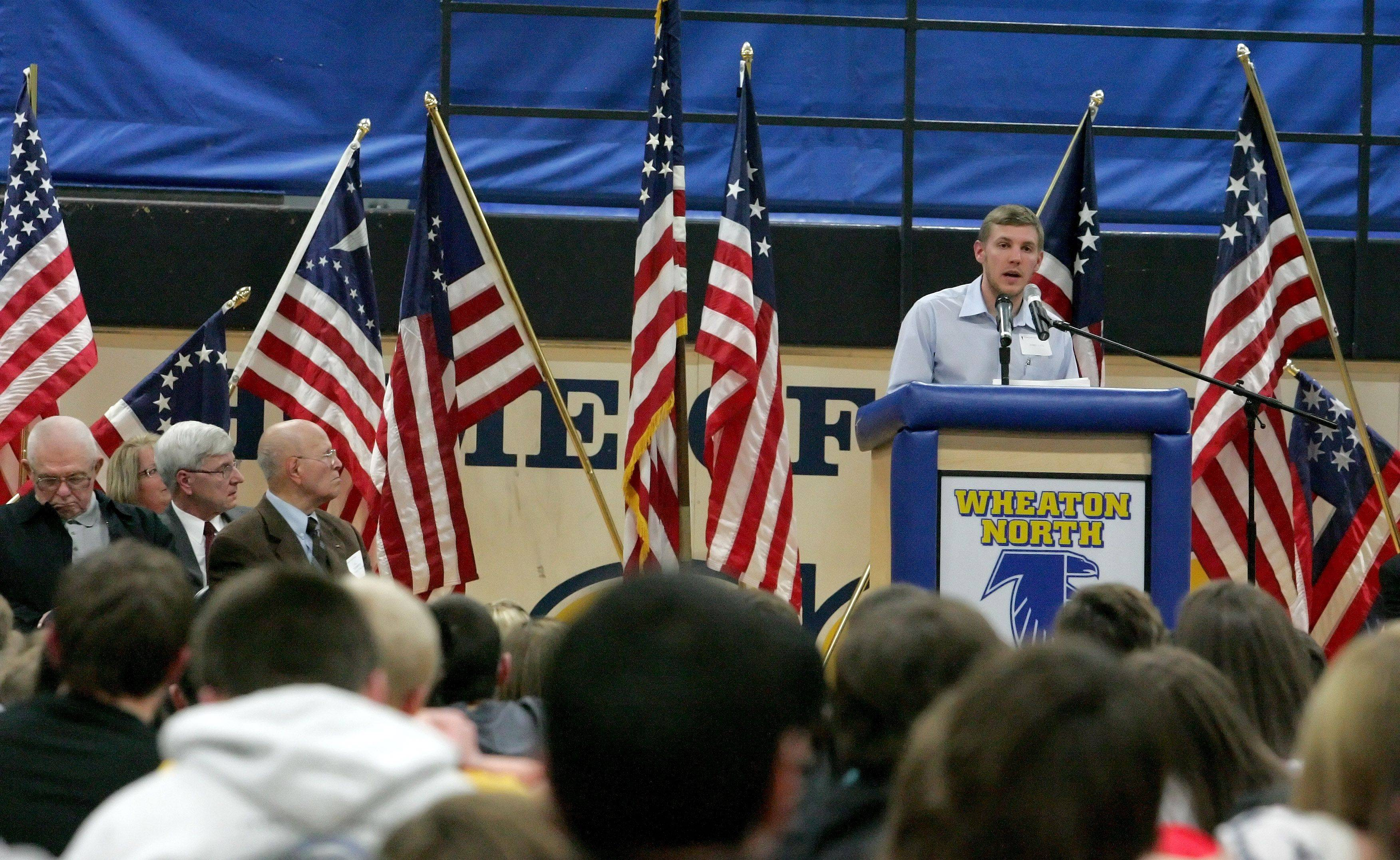 Bobby Kaye speaks to students and veterans during a Veterans Day event honoring his friend Medal of Honor recipient Rob Miller at Wheaton North High School on Thursday. Kaye is a 2002 graduate of Wheaton Warrenville South and has also served two tours of duty in Iraq.