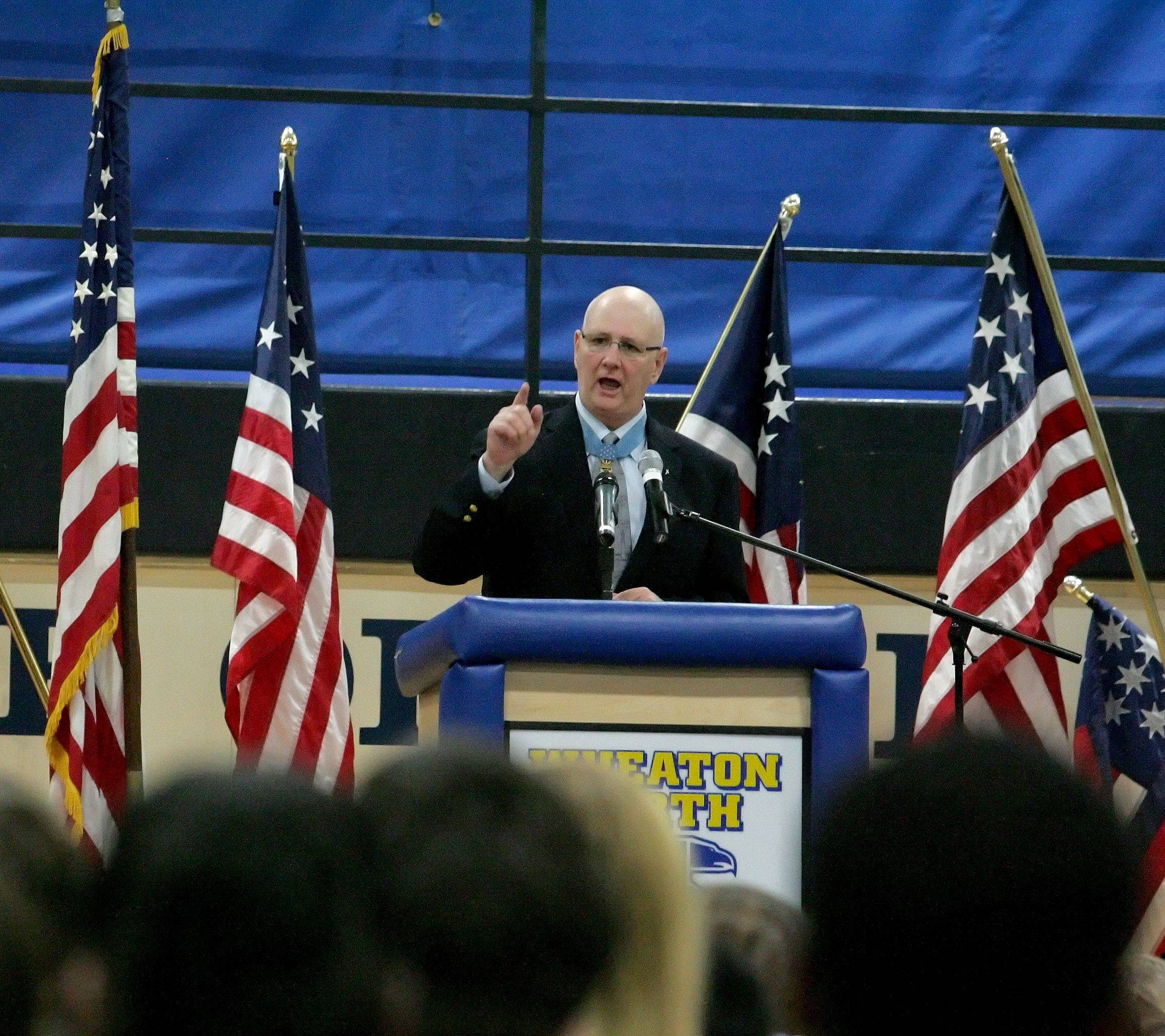 Medal of Honor recipient Allen Lynch speaks at a Veterans Day event honoring Medal of Honor recipient Staff Sgt. Rob Miller at Wheaton North High School.