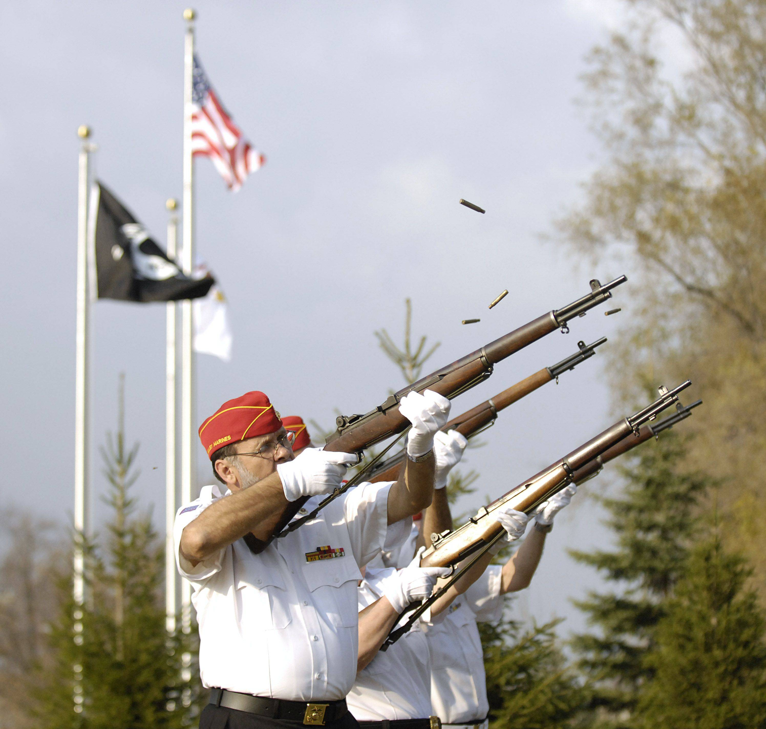Tom Bulin of Oswego serves in the Fox Valley Marine Corps Firing Squad for the Veterans Day ceremony in North Aurora on Thursday, November 11. Bulin served in the Marines from 1965-69.
