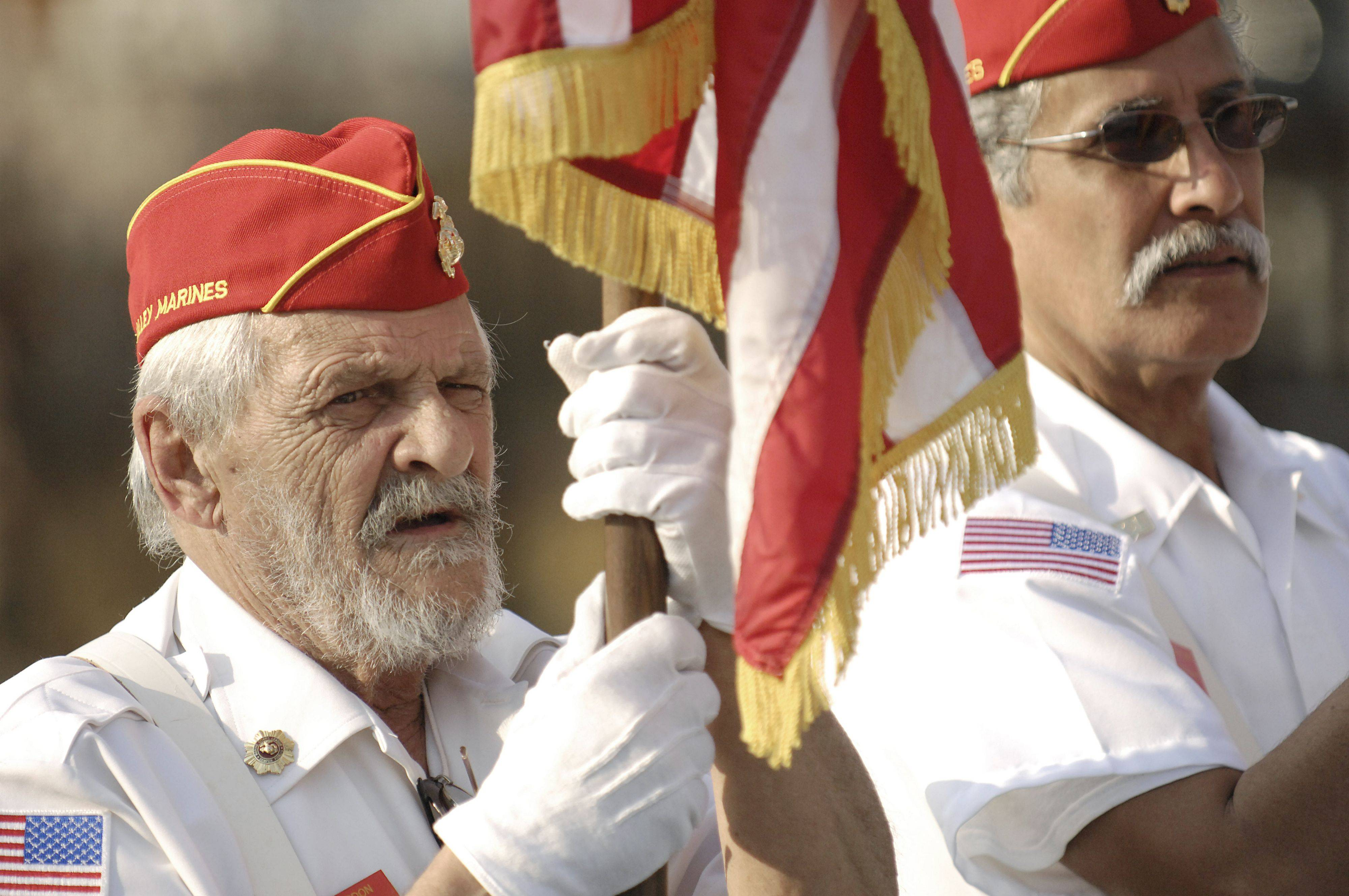 Veteran Frank Gordon of Aurora serves in the Fox Valley Marine Marine Corps Color Guard for the Veterans Day ceremony in North Aurora on Thursday, November 11.