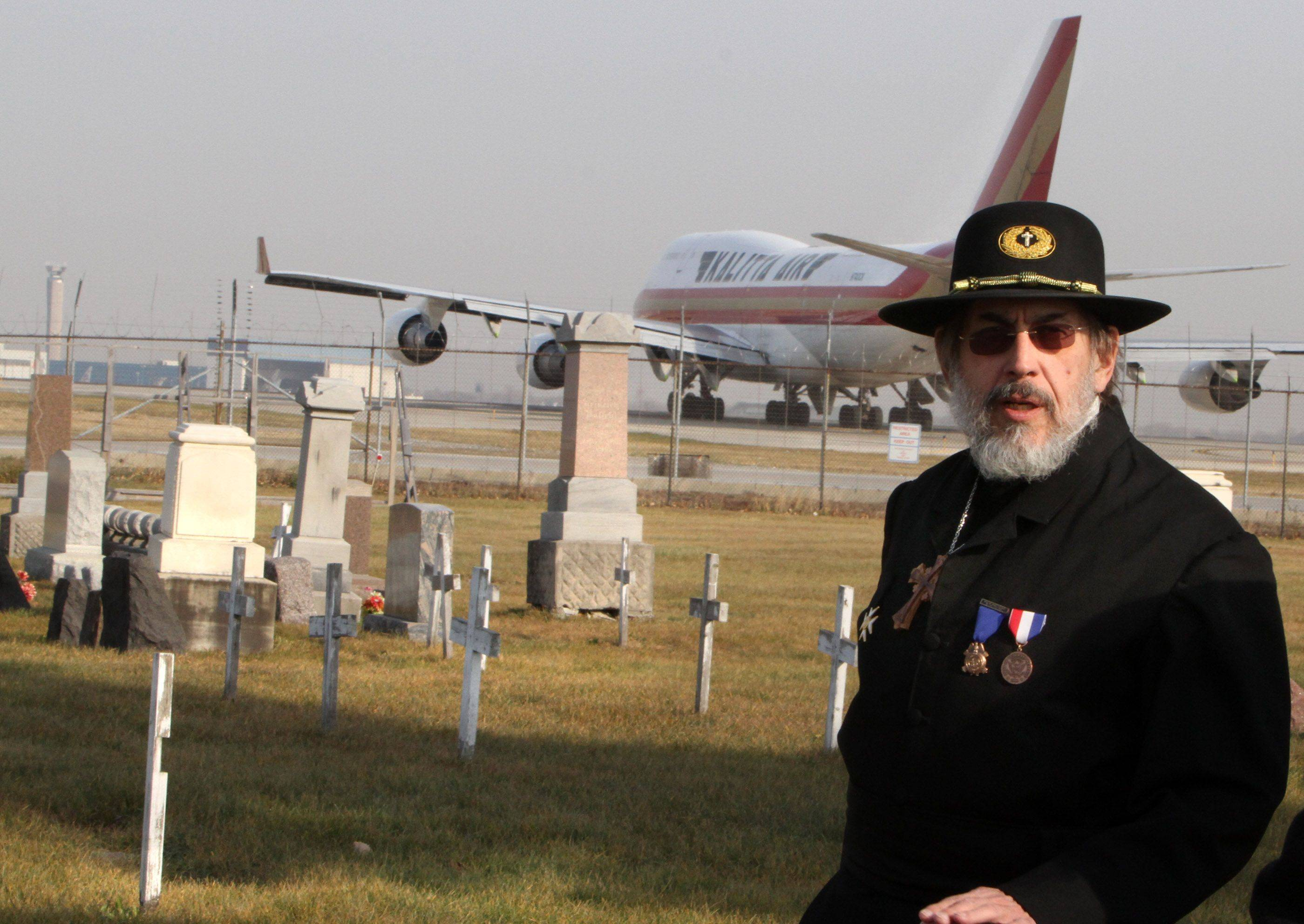 Jerry Kowalski, of Elmhurst, National Chaplain for the Sons of Union Veterans of the Civil War talks after the memorial ceremony on Veterans Day at Johannes Cemetery just south of O'Hare International Airport in Chicago on Thursday, November 11.