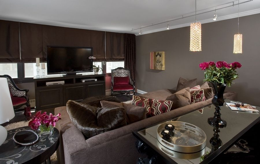Most of the walls are taupey gray, but one is flocked chocolate in this apartment by designers from Susan Fredman Design Group in Chicago.