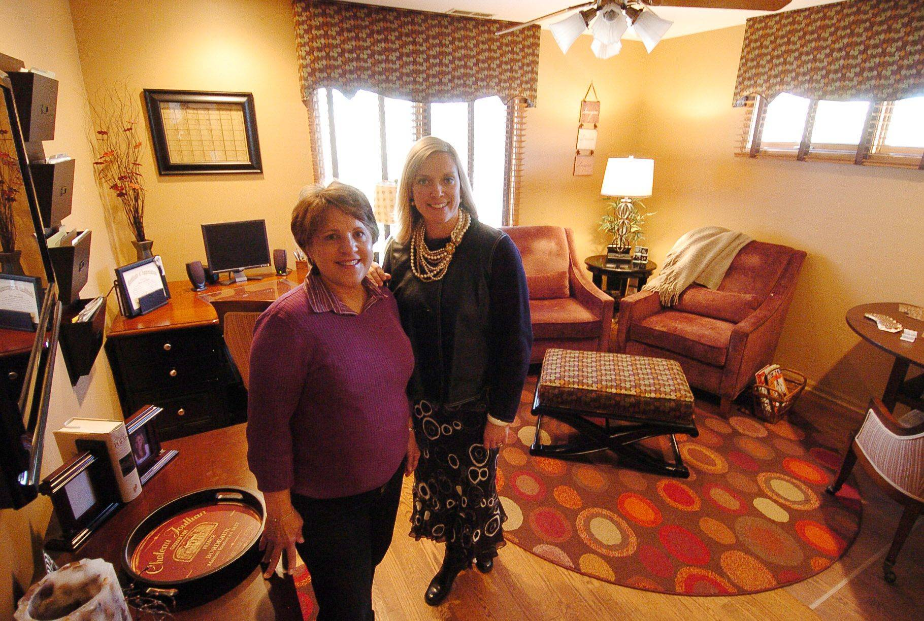 Homeowner Sandy Drizd, left, and designer Mollee Johnson show off the multipurpose room of the Drizds' Buffalo Grove home.