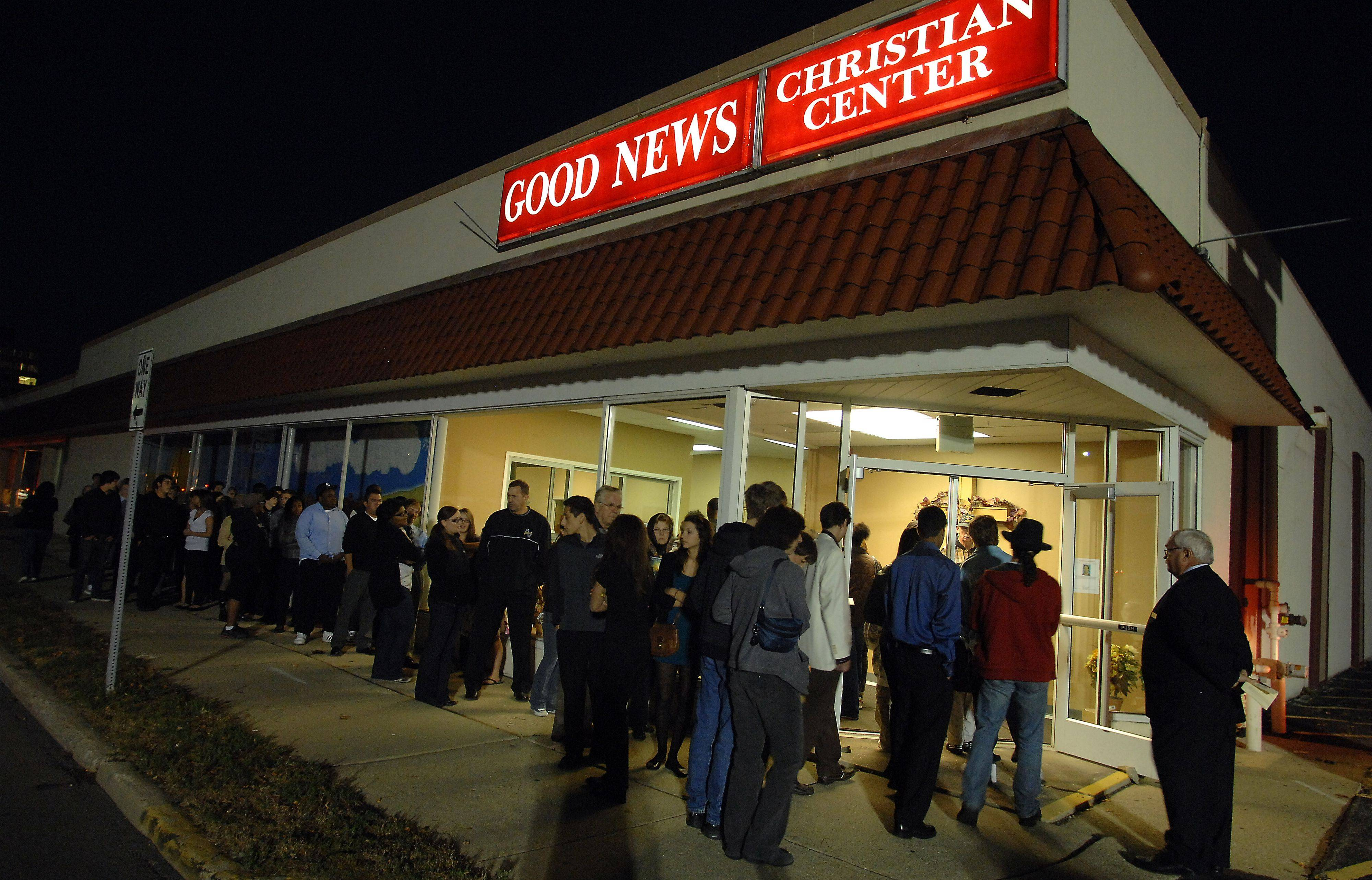 People line Lee Street Friday evening, waiting to pay their respects to Choice Taylor's family.