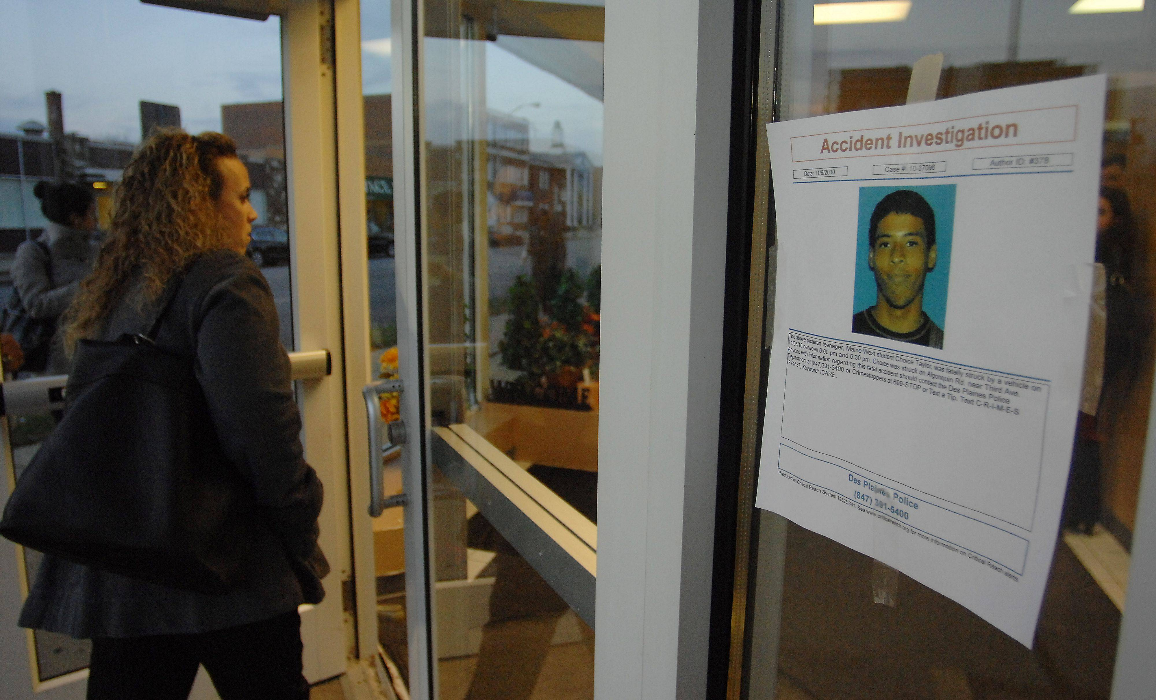 People file into the Good News Christian Center in Des Plaines as a poster taped the window reminds visitors the people are still looking for the truck driver.