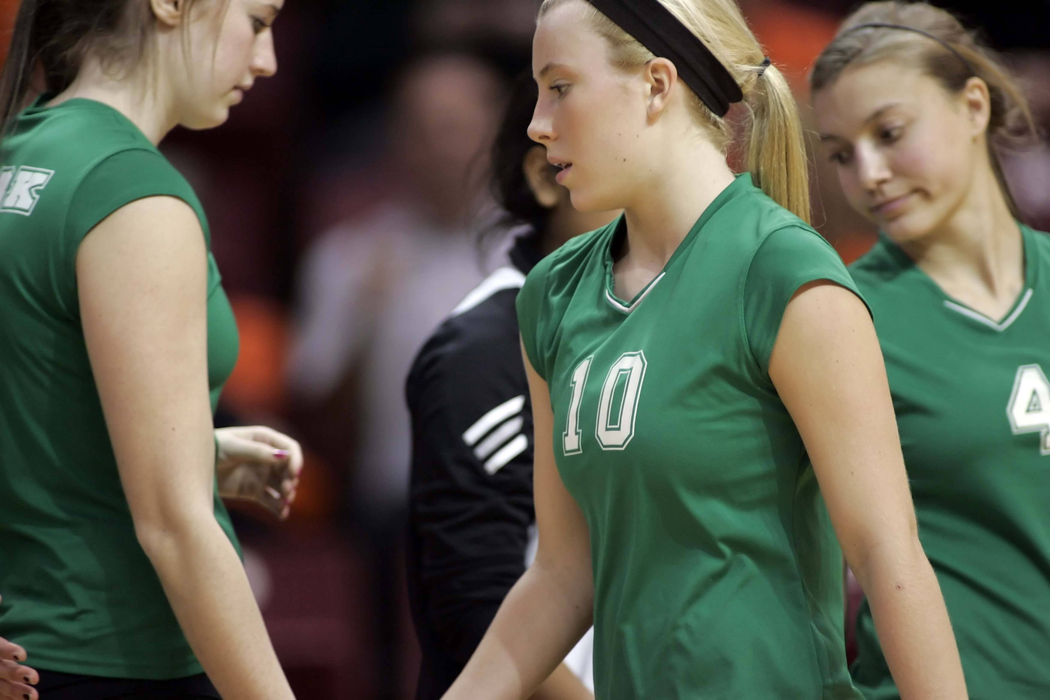 York setter Katie Gallagher reacts after losing in the third match against Lyons in an IHSA Class 4A State semi-final match .