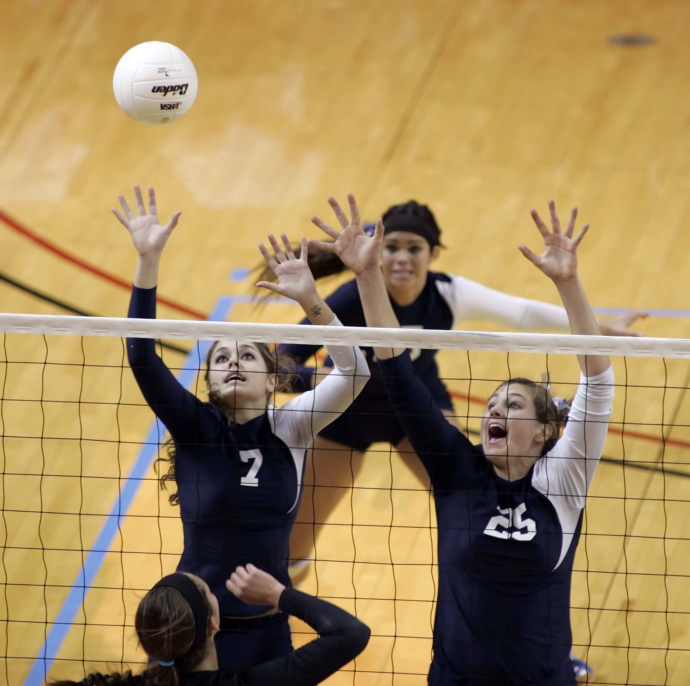 Cary-Grove outside hitter Allison Whimpey, 7, and Cary-Grove middle blocker Ashley Rosch, 25, attempt a block during the Cary-Grove vs Edwardsville in the IHSA Class 4A State semi-final match Friday, November 12, 2010 at Redbird Arena in Normal.