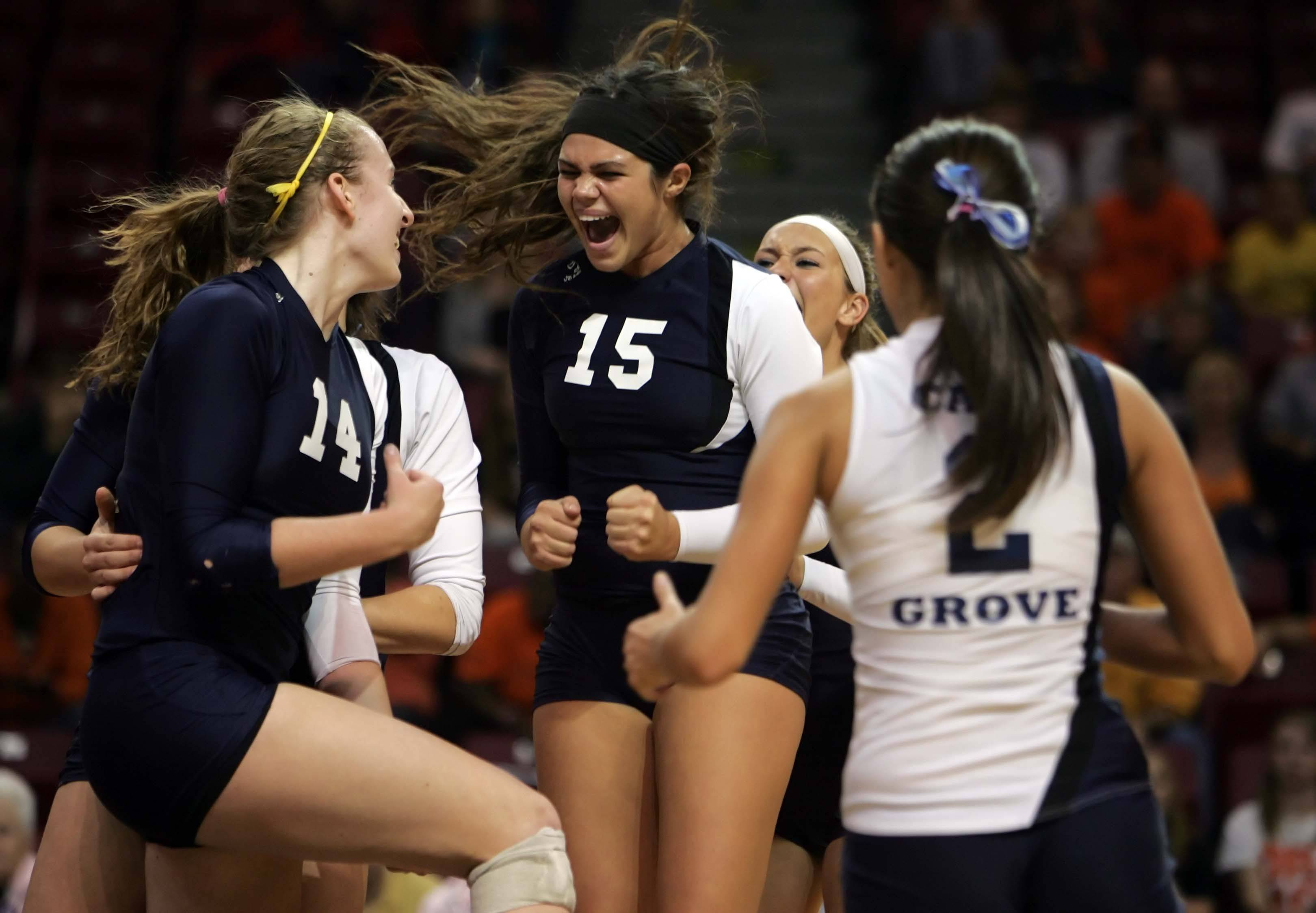 Cary-Grove setter Colleen Smith, 15, celebrates the Trojans win with her teammates after the Cary-Grove vs Edwardsville in the IHSA Class 4A State semi-final match Friday, November 12, 2010 at Redbird Arena in Normal.
