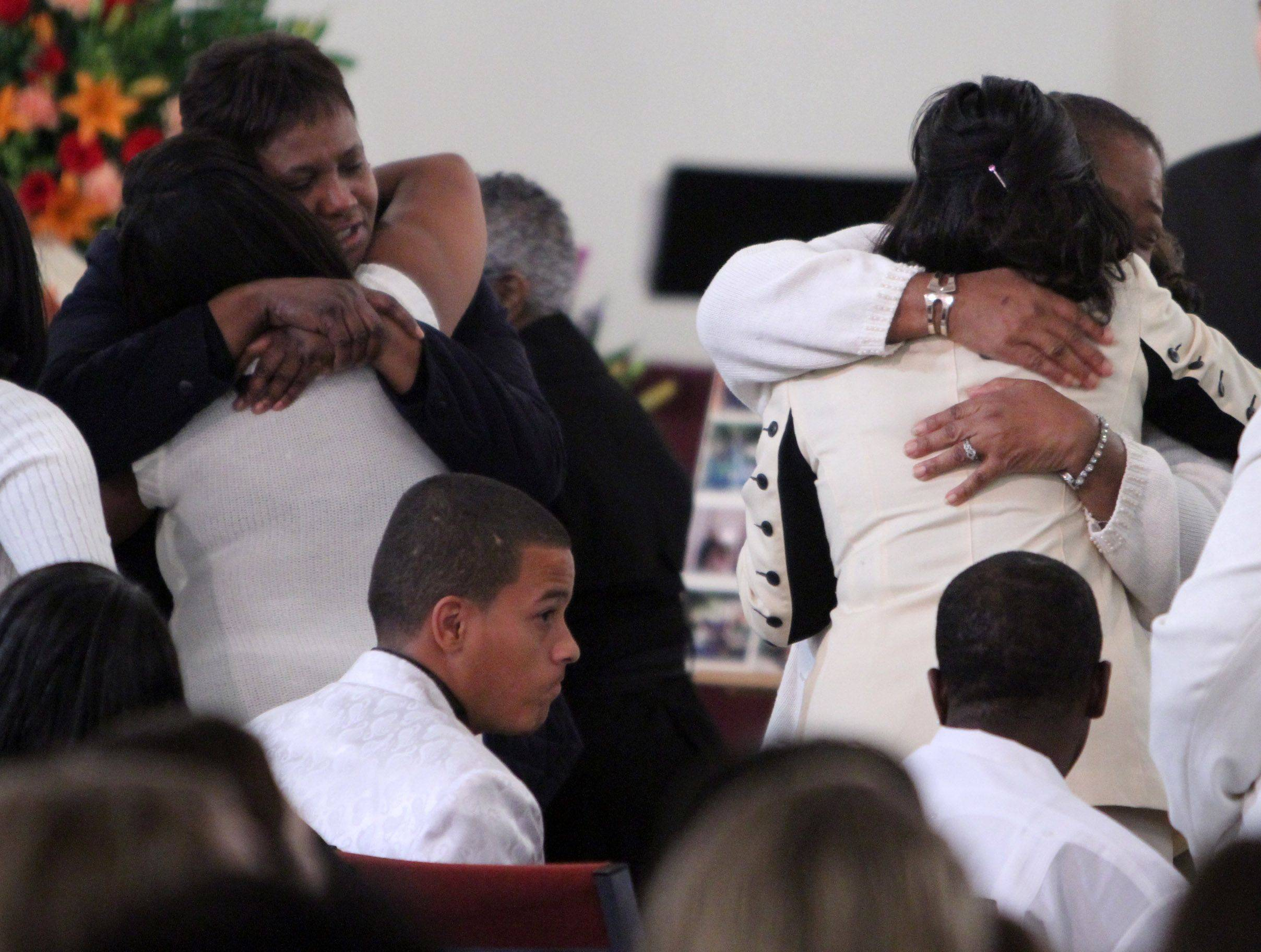 Loreene Taylor, far right, receives a hug after the funeral service for her son Choice Taylor at Good News Christian Center in Des Plaines Saturday.