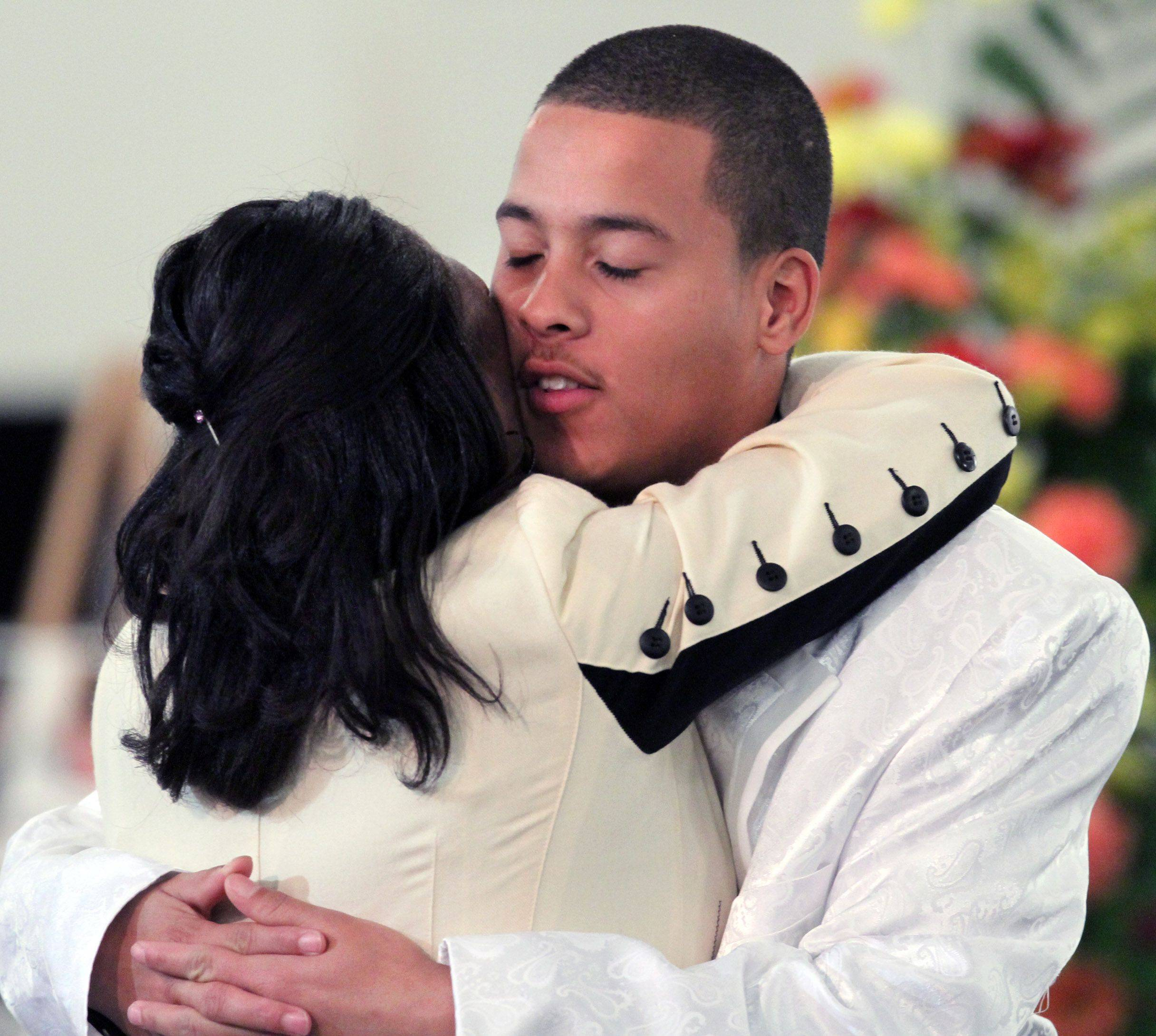 Chance Taylor hugs his mother, Loreene, during the funeral service for his twin brother, Choice, at Good News Christian Center in Des Plaines Saturday.
