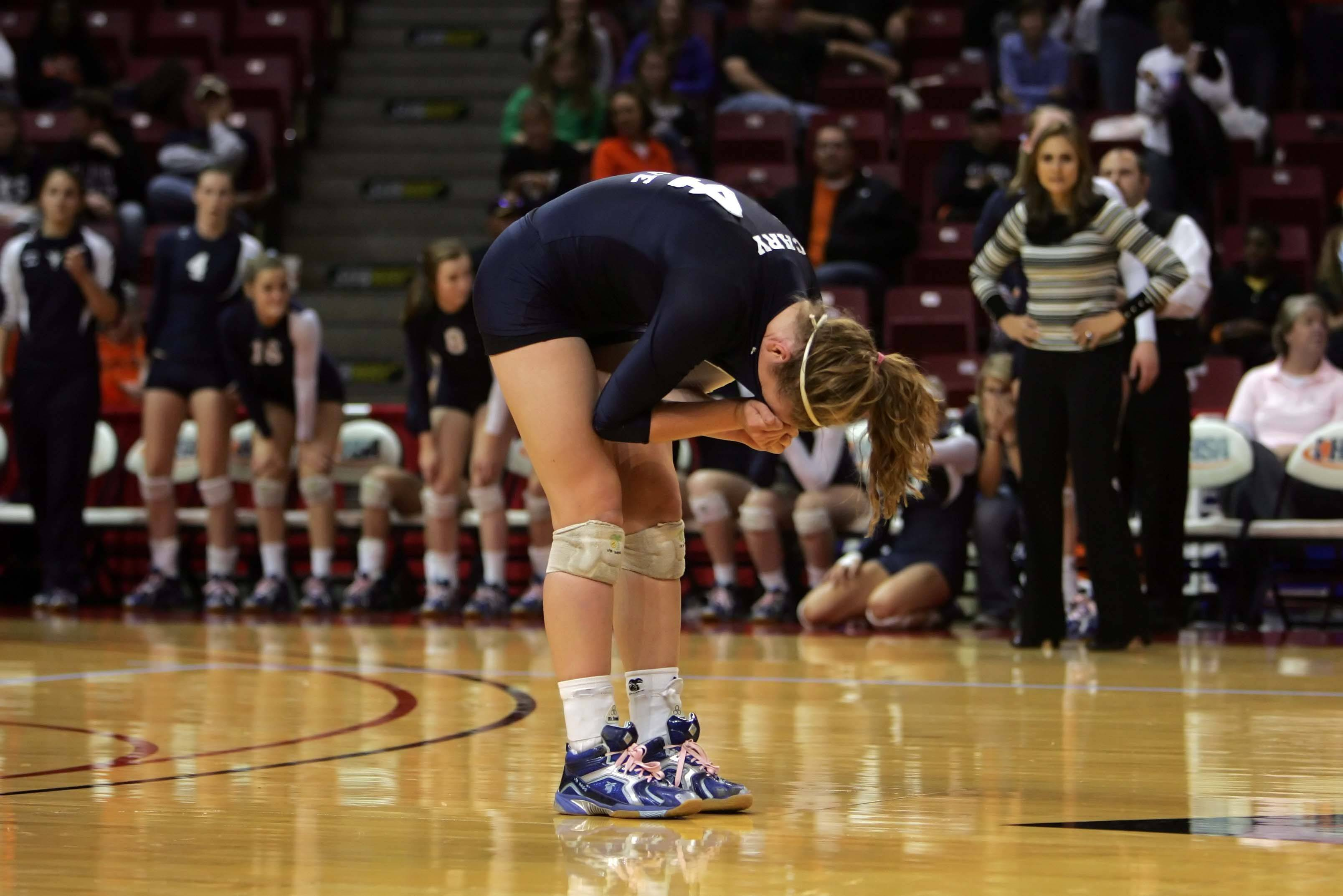 Cary-Grove middle blocker Suzy Dorsey, 4, reacts after their loss to Lyons in the IHSA Class 4A State championship match Saturday, November 13, 2010 at Redbird Arena in Normal. The Trojans lost the match in three games and finished second.