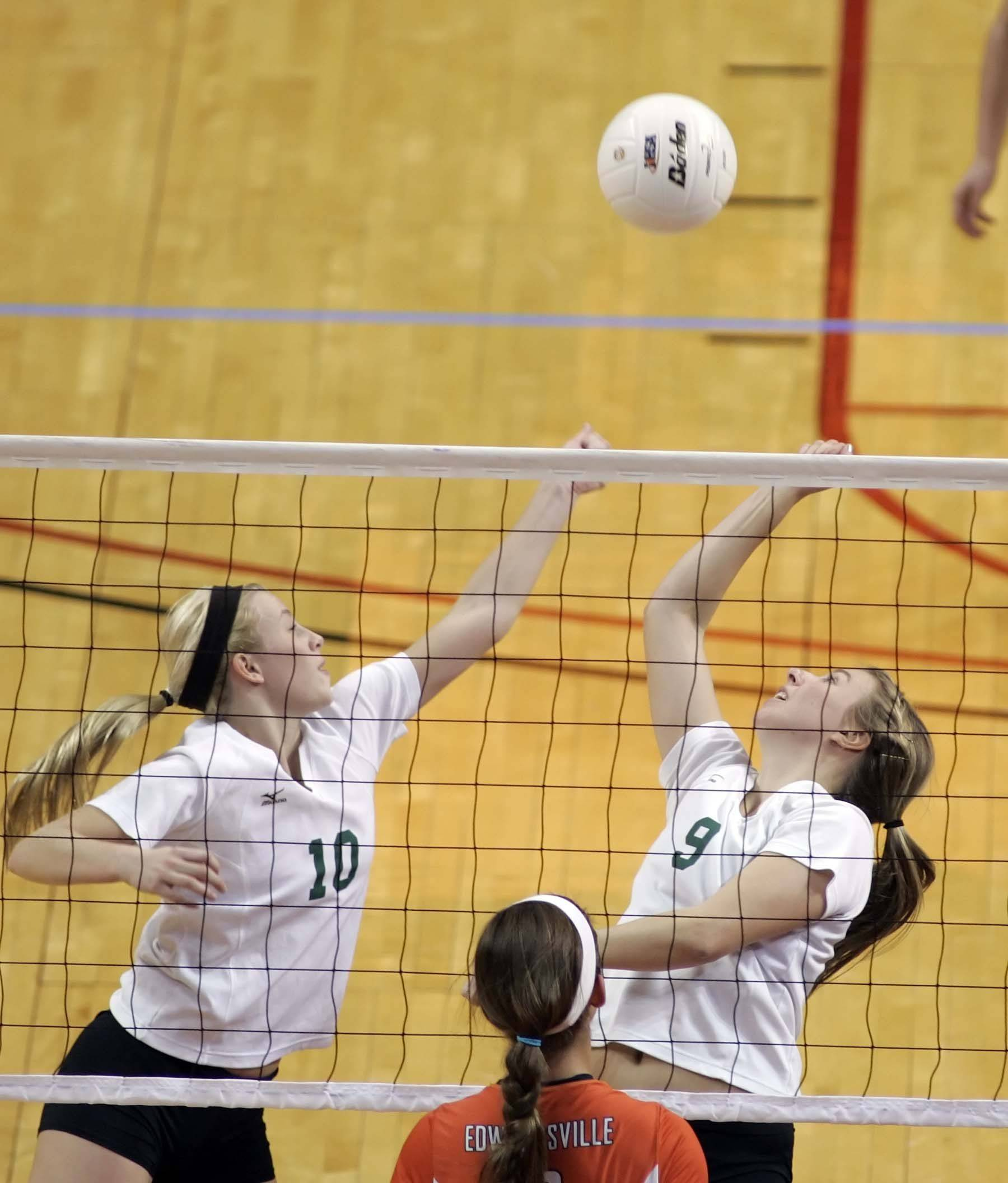 York setter Katie Gallagher, 10, and middle blocker Morgan Semmelhack, 9, try to reach a shot during the IHSA Class 4A third place match Saturday, November 13, 2010 at Redbird Arena in Normal. York lost the game and took fourth place in the tournament.