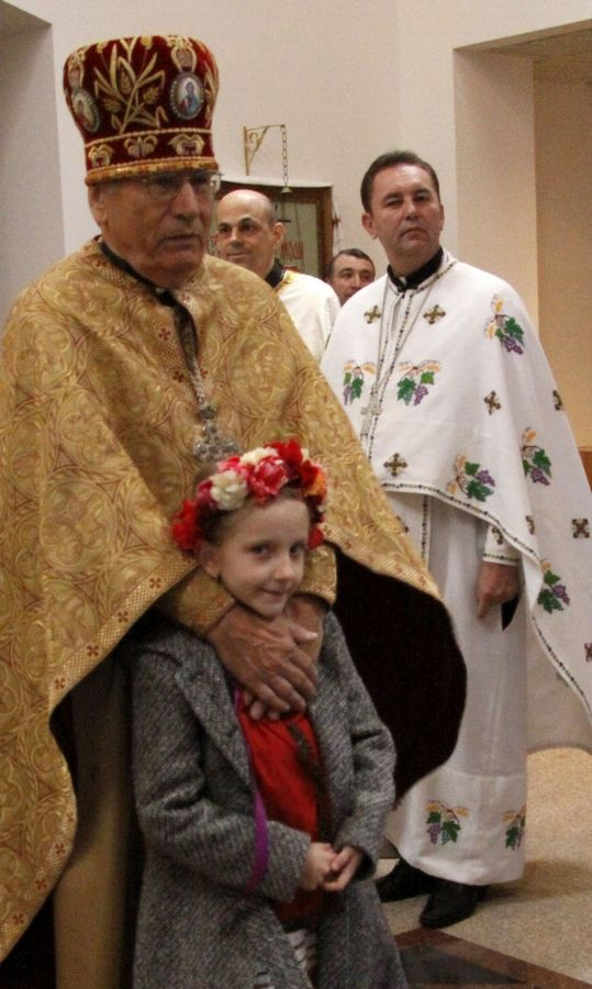 Father Victor Poliarny and his granddaughter, Tanya Fedak, await the arrival of Patriarch Filaret of Kyiv, the leader of the Ukrainian Orthodox Church Sunday at the St. Andrew Ukrainian Orthodox Church in Bloomingdale.