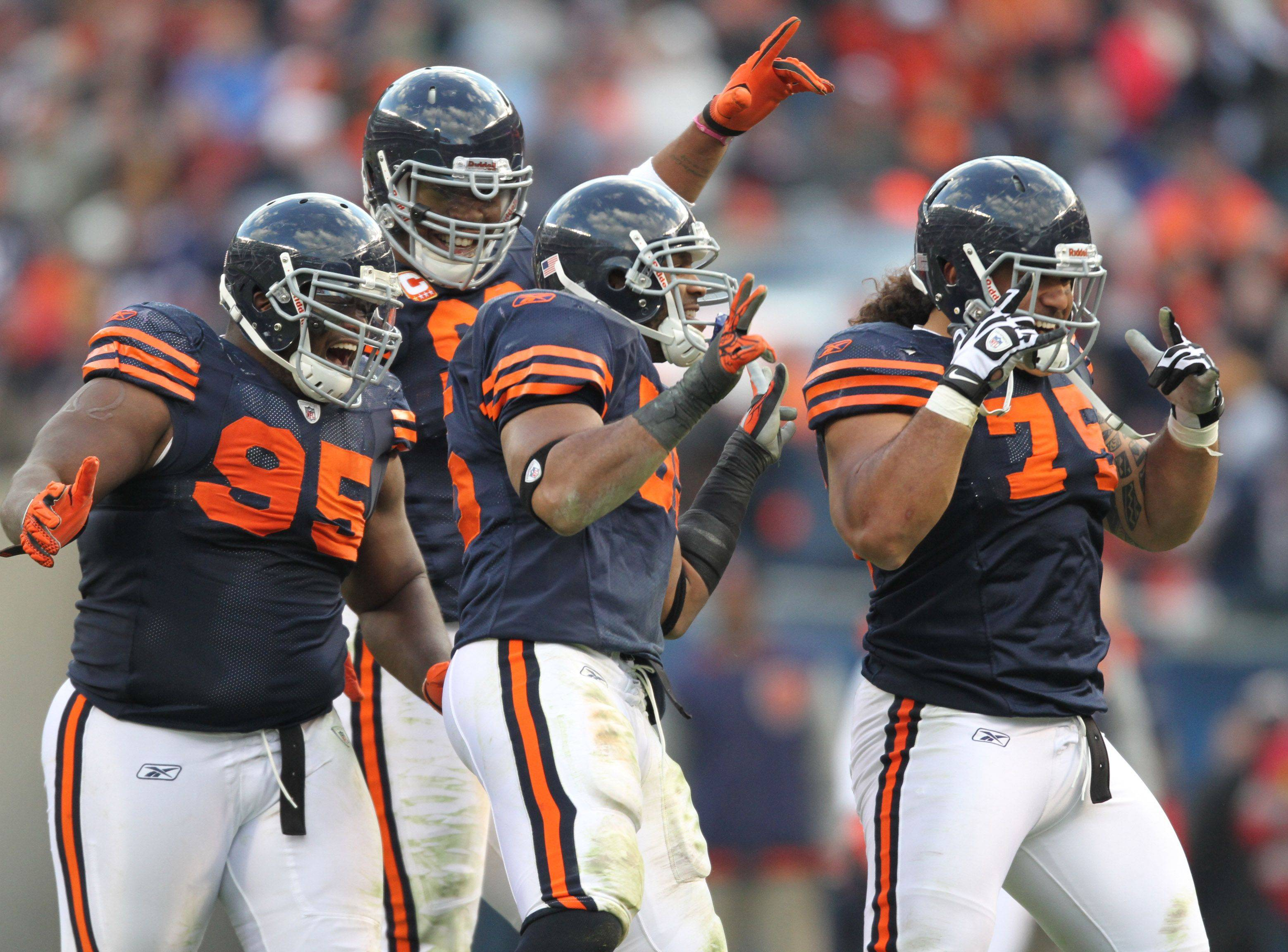 Chicago Bears celebrate an interception in the fourth quarter by Lance Briggs against Minnesota Vikings in the second half of the Chicago Bears against Minnesota Vikings at Soldier Field on Sunday, November 14.