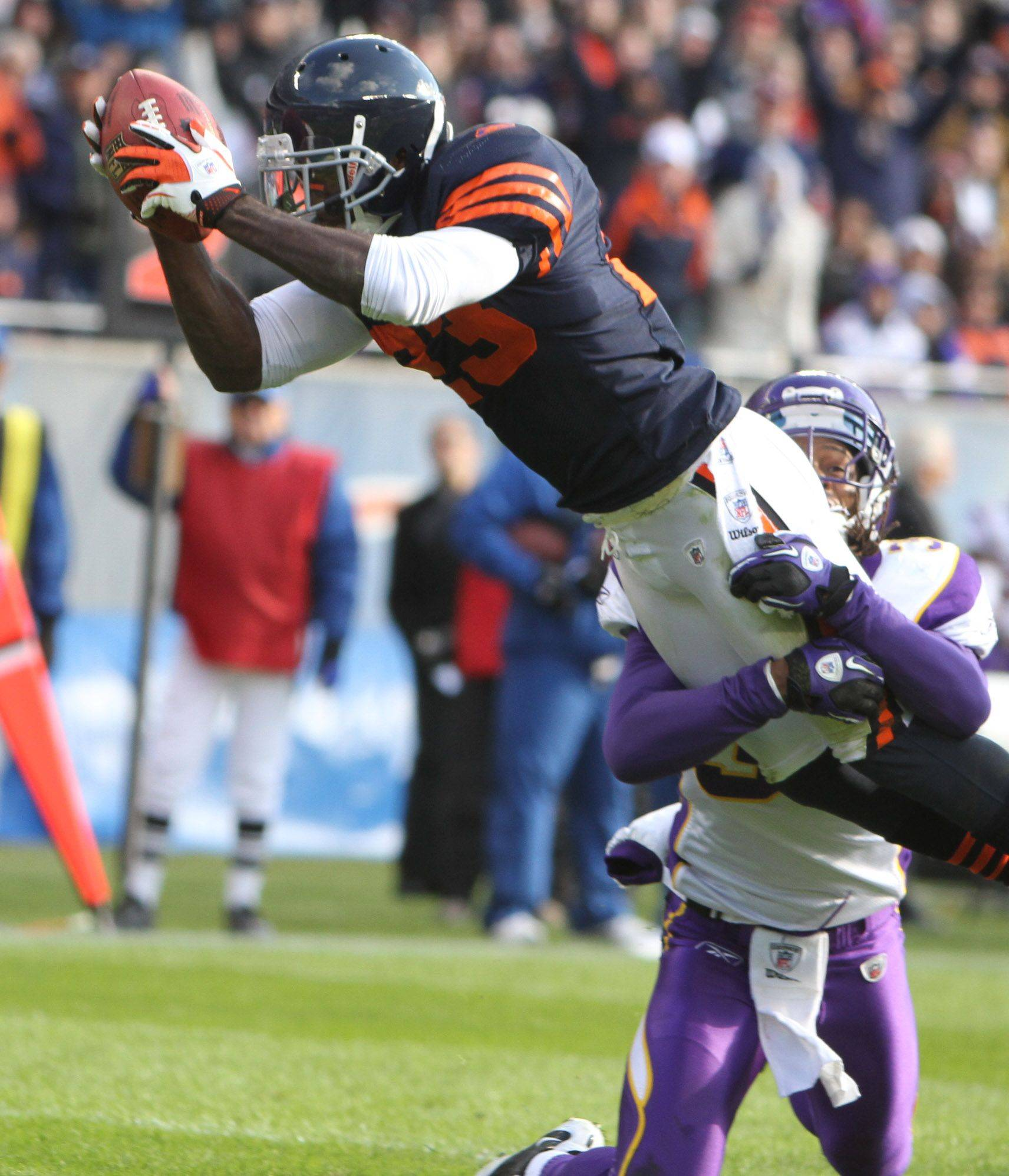Chicago Bears' Devin Hester dives over the goal line as he is pulled down by Minnesota Vikings' Chris Cook at the end of the first half.