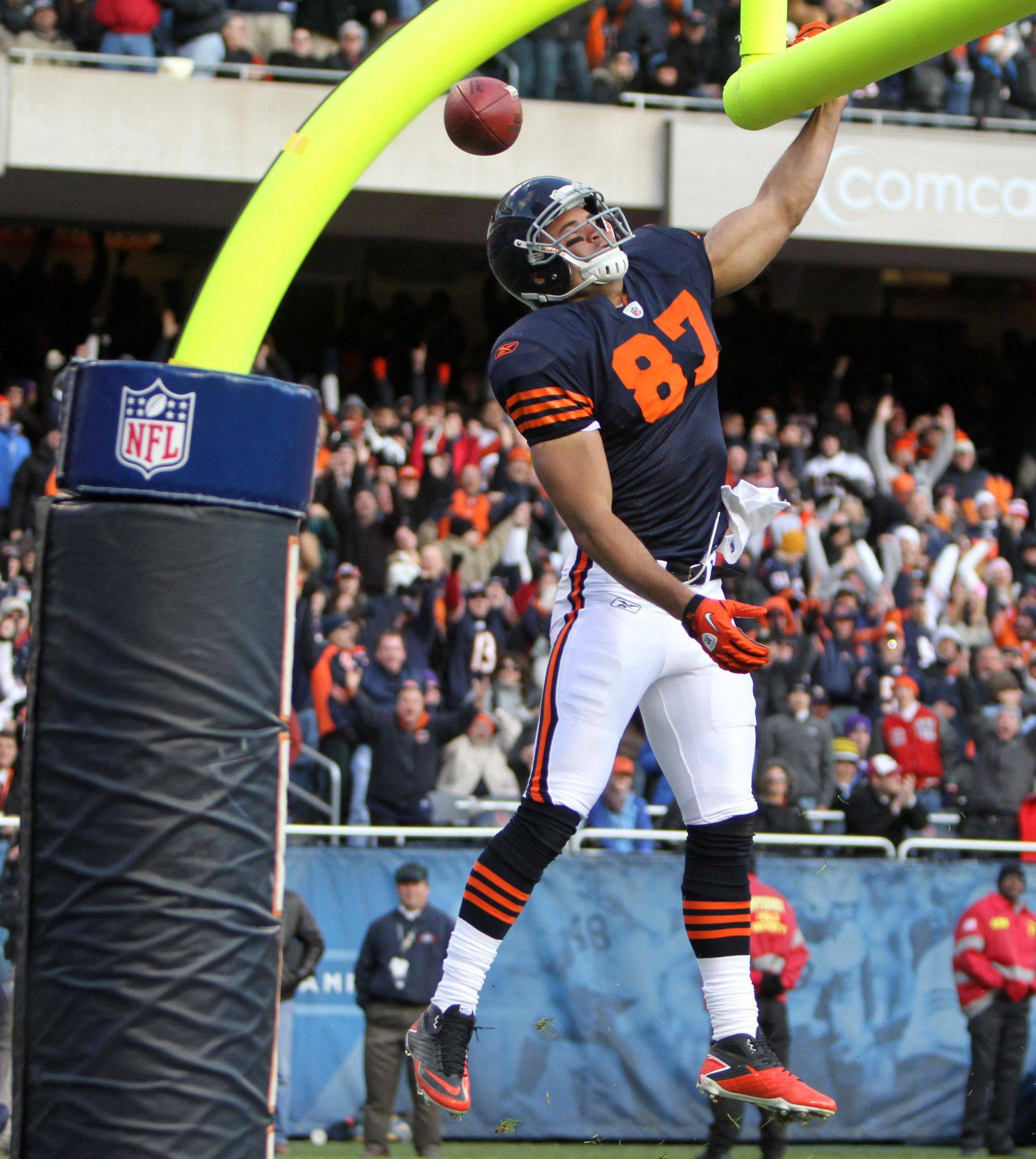 Chicago Bears' Kellen Davis dunks the ball over the goal post after scoring a touchdown against Minnesota Vikings in the second half.