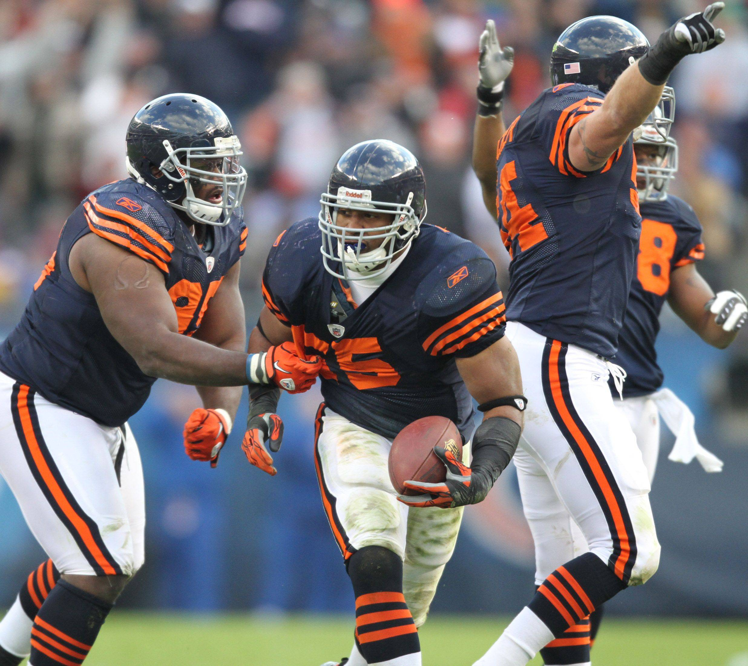 Chicago Bears celebrate an interception in the fourth quarter by Lance Briggs against Minnesota Vikings in the second half.