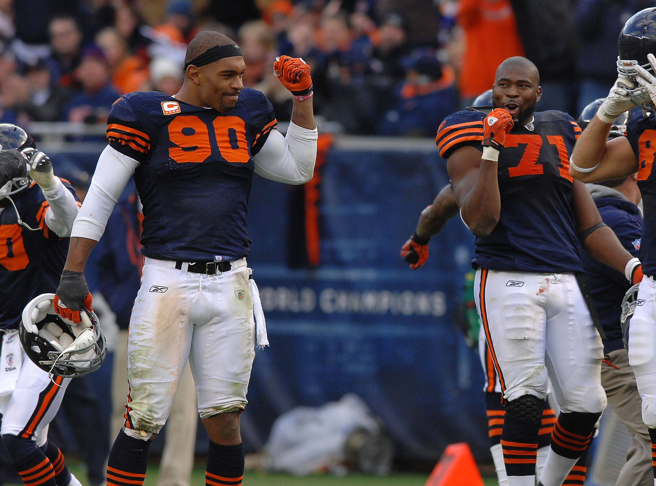 Chicago Bears Julius Peppers and Israel Idonije celebrate Lance Briggs interception in the 4th quarter.