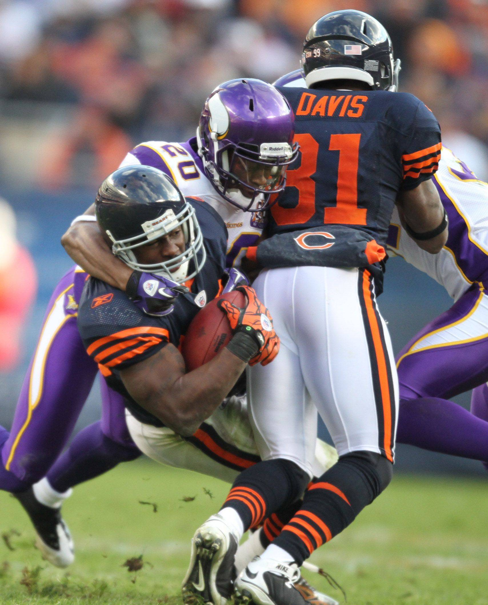 Chicago Bears' Chester Taylor is pulled down by Minnesota Vikings' Madieu Williams in the second half.