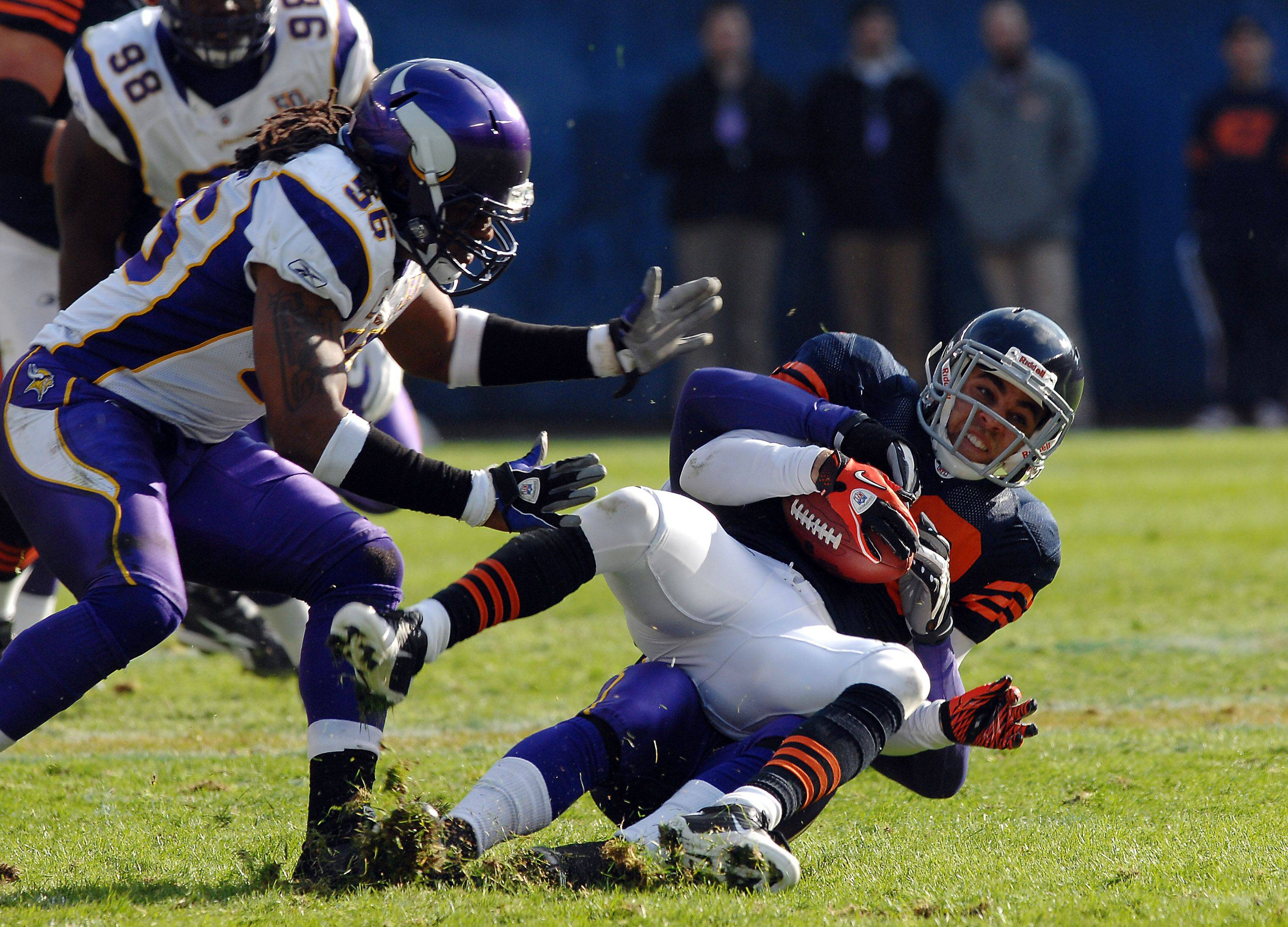 Chicago Bears Johnny Knox gets wrapped up by Minnesota's defense on a pass play in the second quarter.