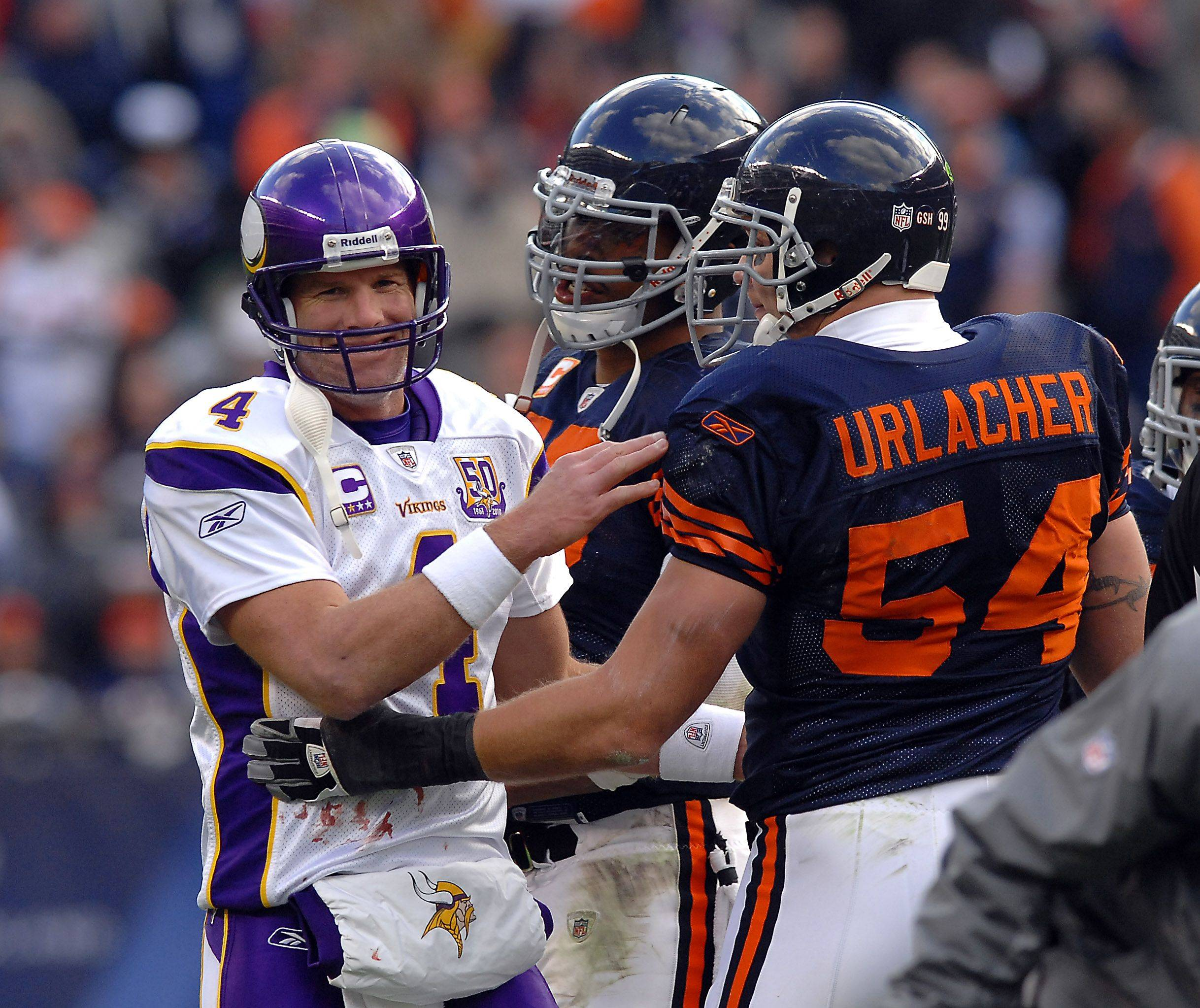 Minnesota's Brett Favre and Chicago Bears Brian Urlacher share a moment during the game perhaps the last time as it might be the last season for Favre.