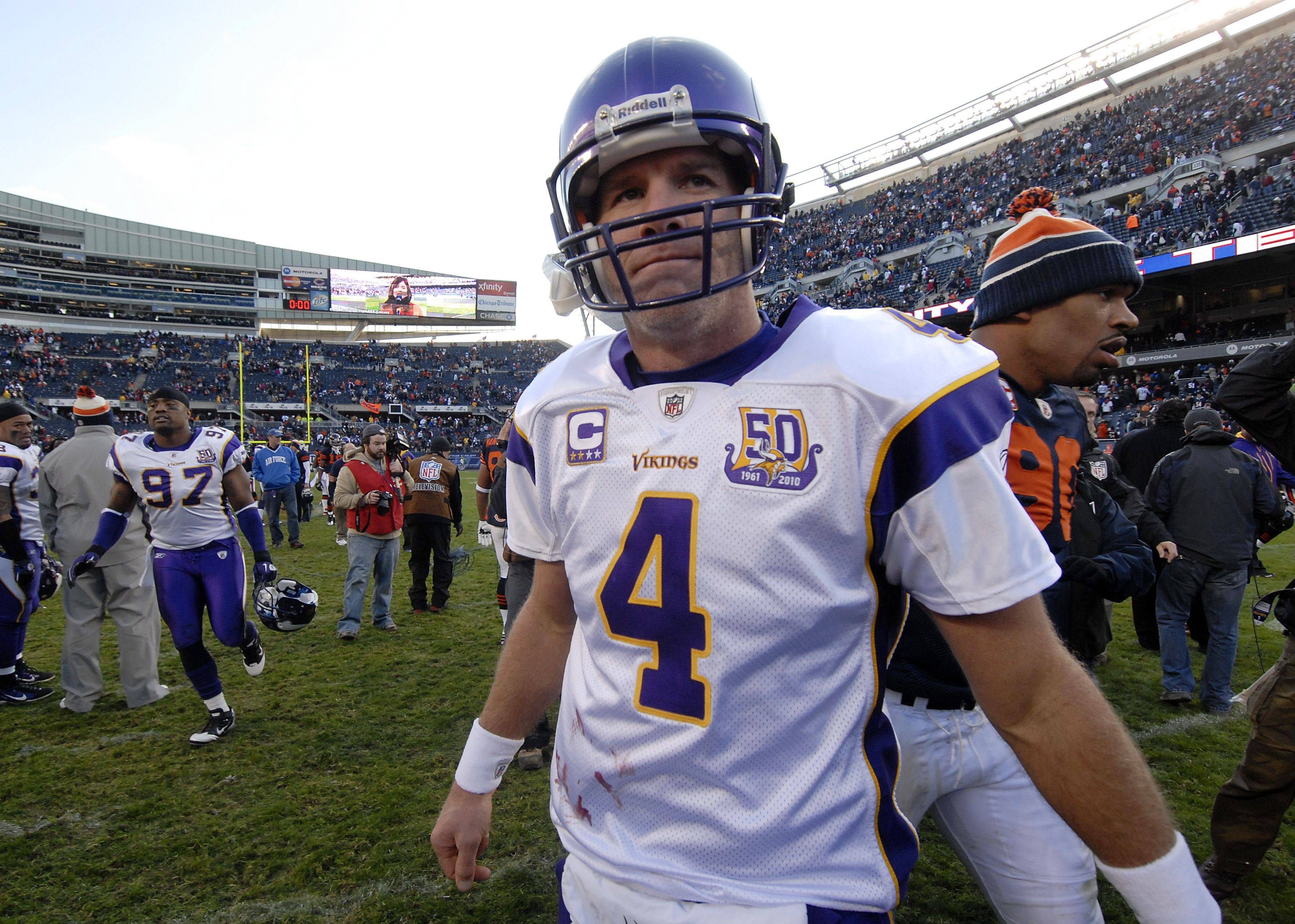 Minnesota's quarterback Brett Favre walks off the field after losing to the Bears, perhaps for the last time as a player.