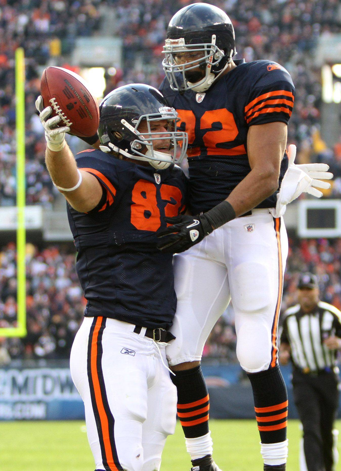 Chicago Bears' Greg Olsen celebrates his touchdown with Matt Forte against Minnesota Vikings in the first half.