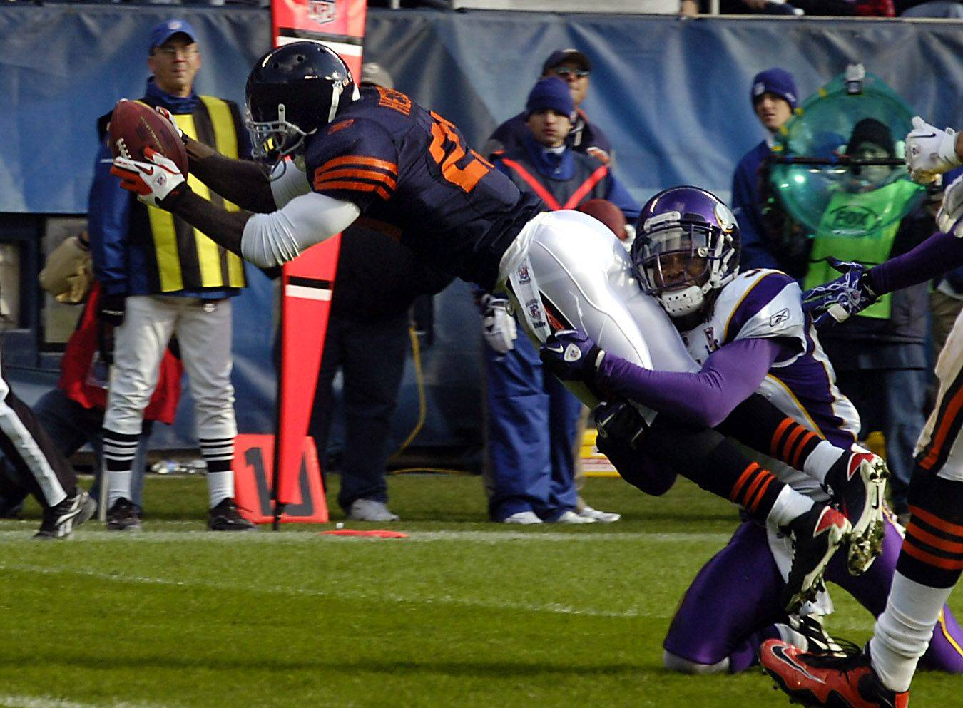Chicago Bears Devin Hester score a second-quarter touchdown as Minnesota's Chris Cook is unable to stop him.