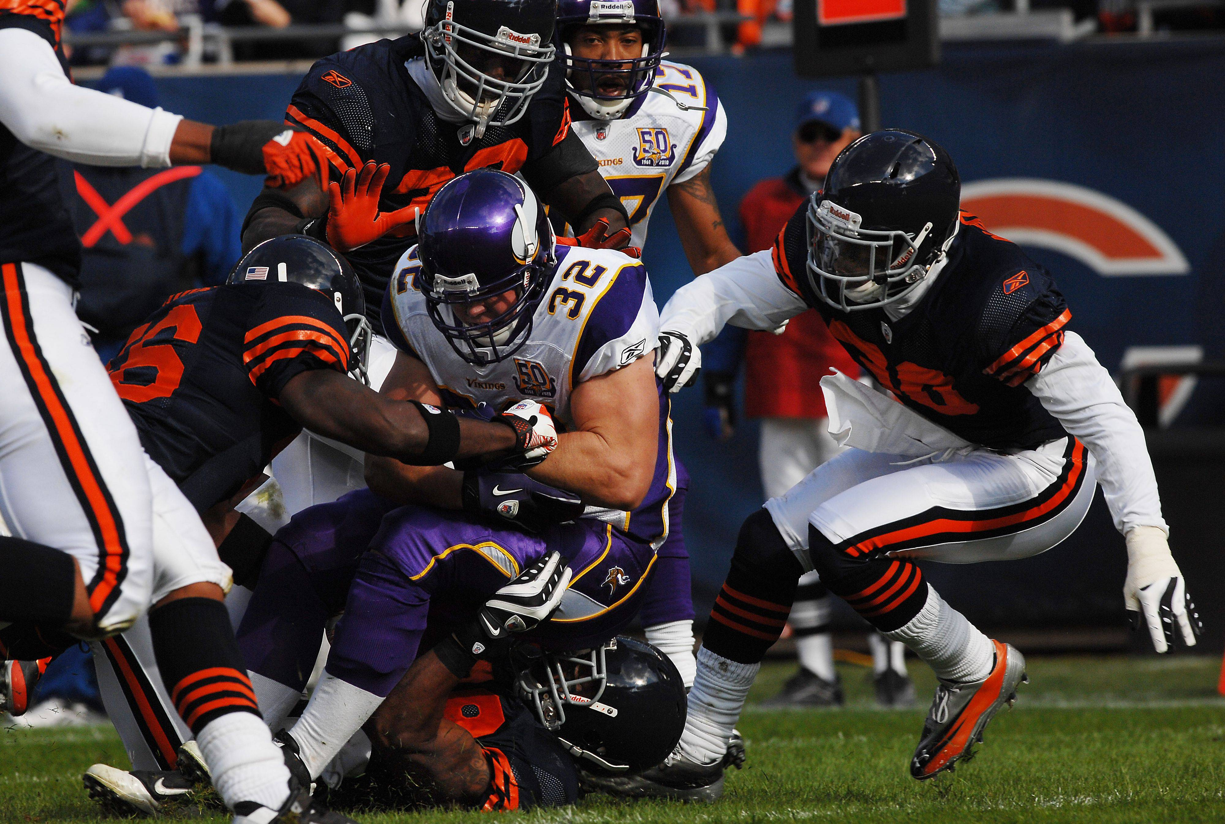Chicago Bears defense wraps up Minnesota's Toby Gerhart for short yardage in the second quarter.