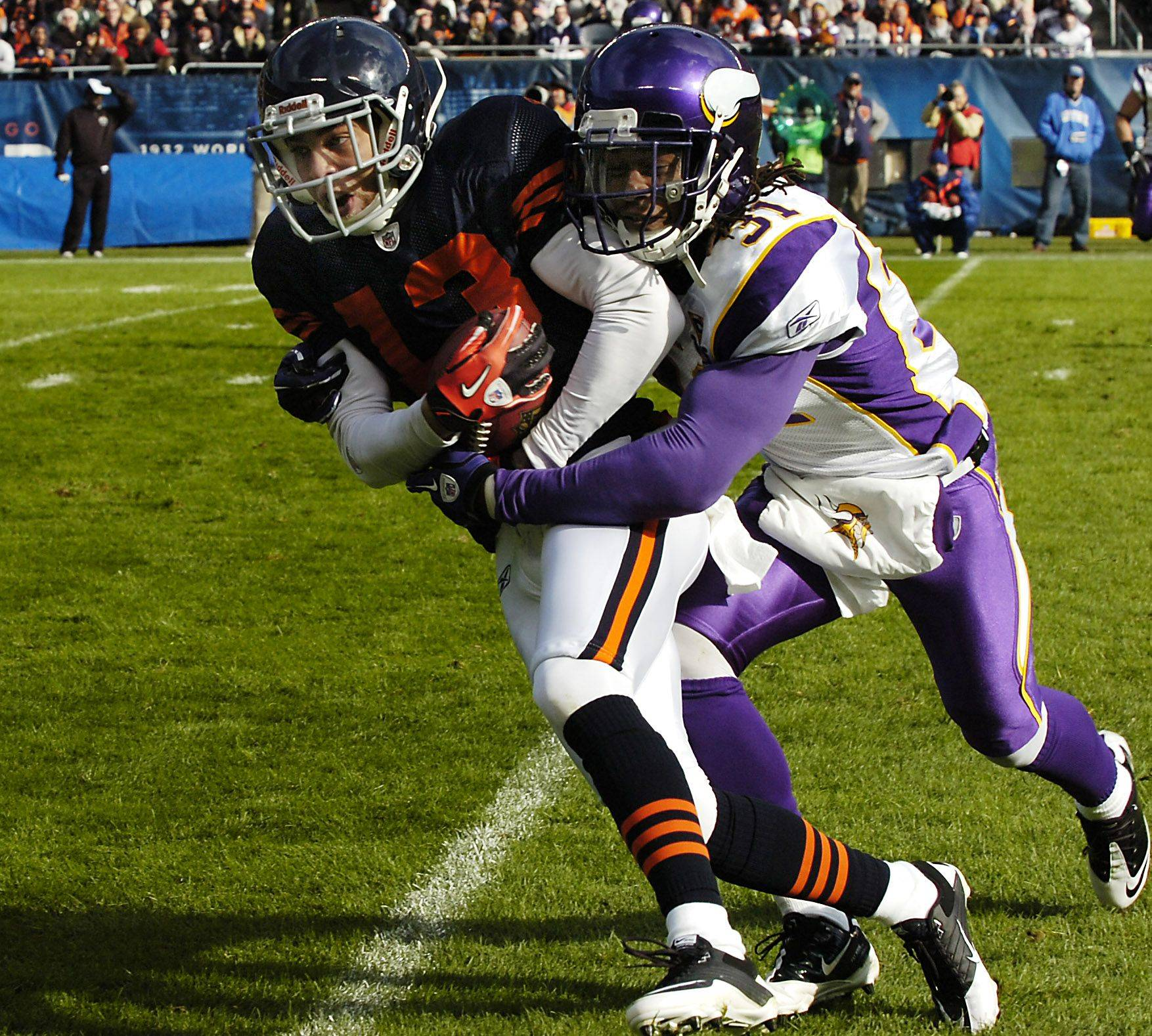 Chicago Bears Johnny Knox gets wrapped up by Minnesota's Chris Cook on a pass play in the second quarter.