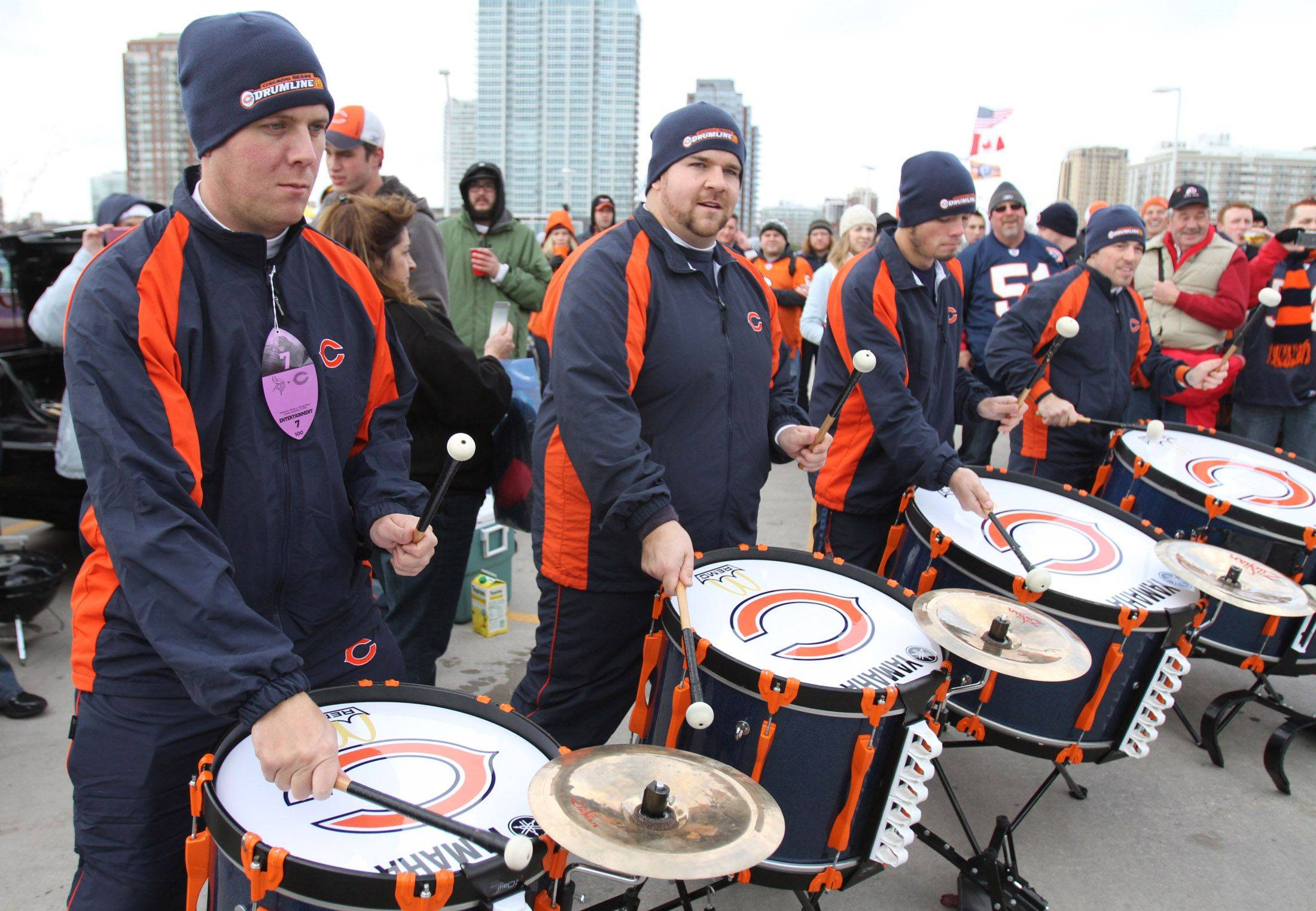 Matt Janus, left, a 1998 graduate of Prospect High School and a current band instructor, plays with the Chicago Bears drum major in the parking lot of Soldier Field before the game with Minnesota Vikings.