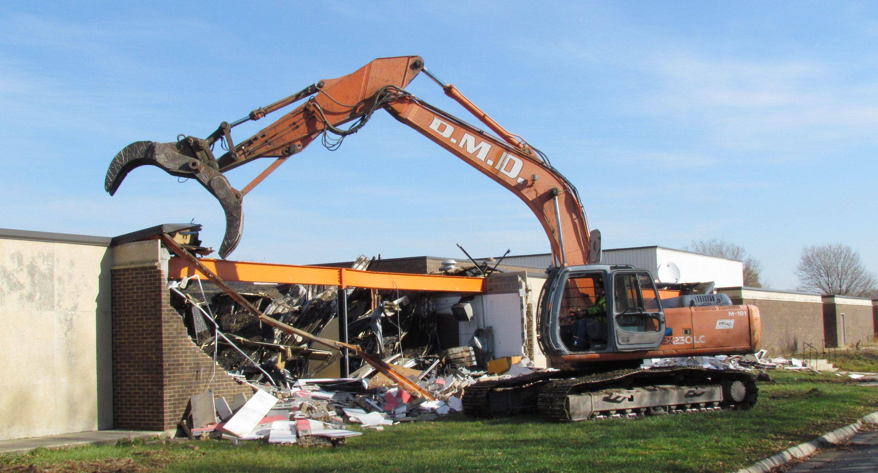 Demolition work began Monday morning at the former Driscoll Catholic High School in Addison.