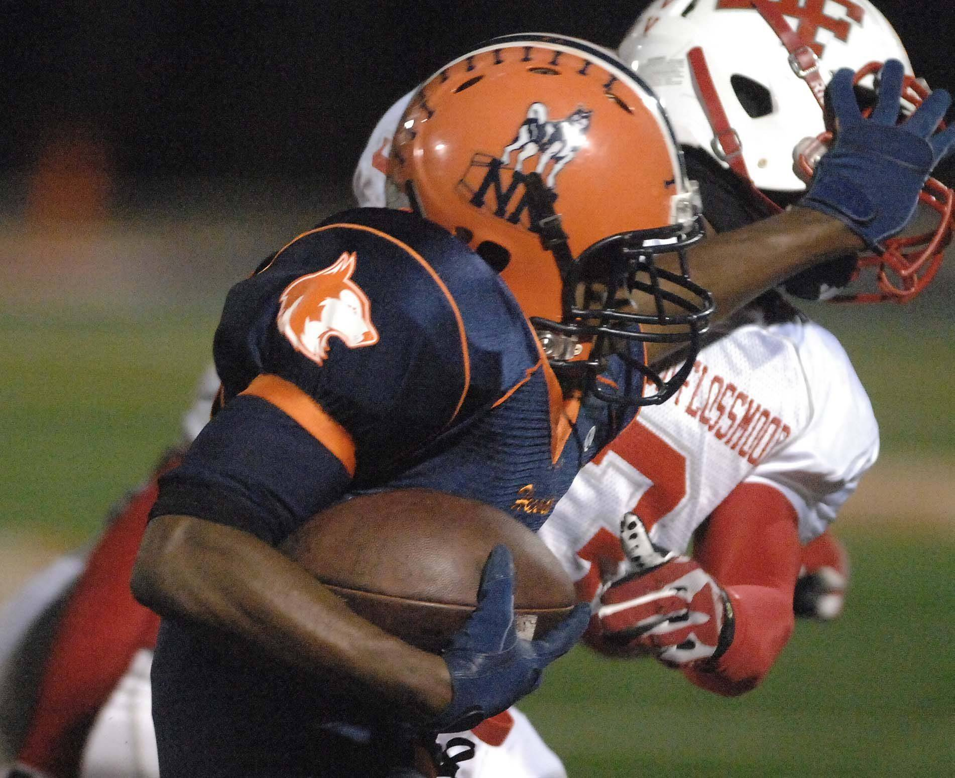 Tarrell Tucker of Homewood-Flossmoor, back, is pushed out of the way by Antonio Owens of Naperville North Friday.