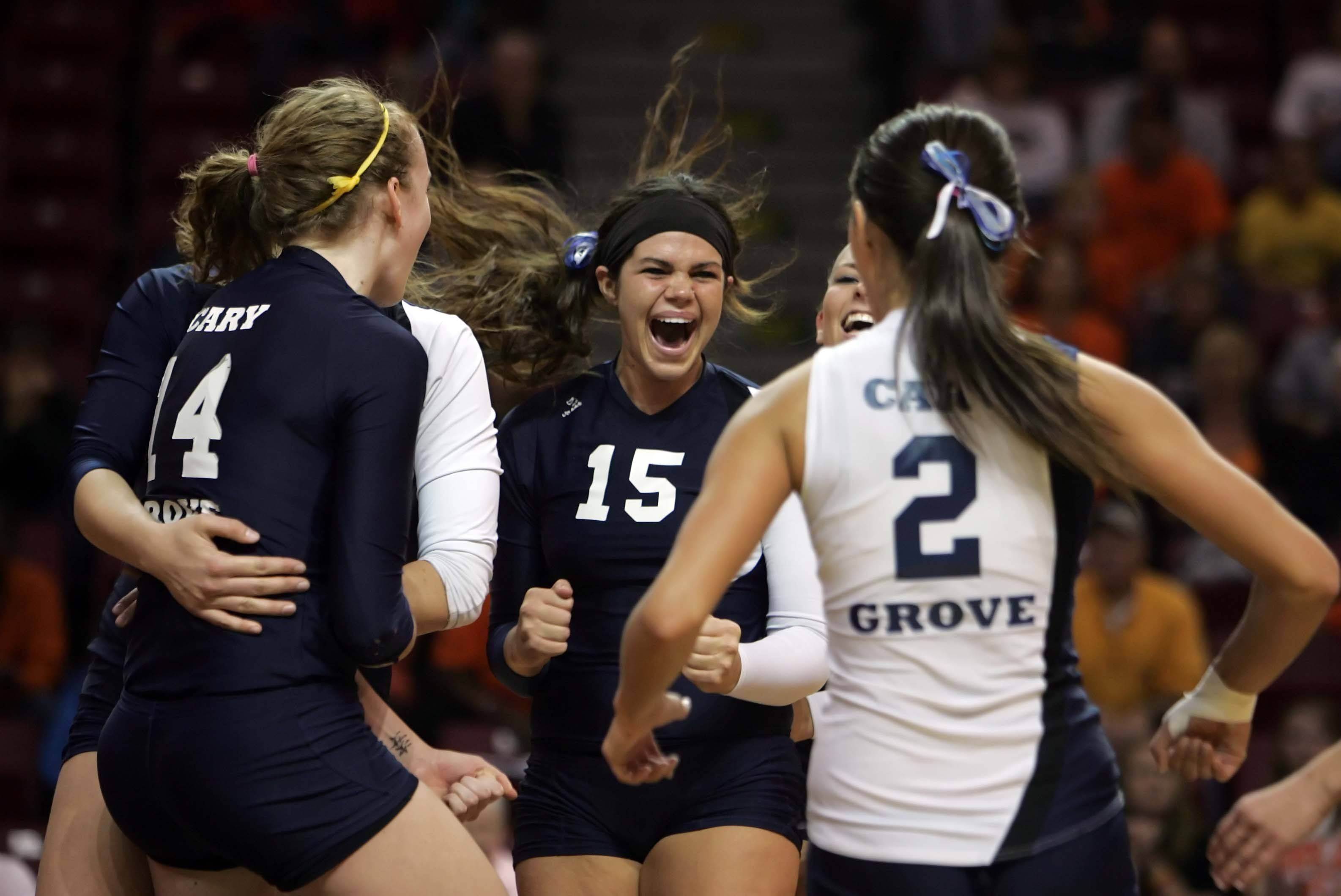 Cary-Grove setter Colleen Smith, 15, celebrates the Trojans win over Edwardsville with her teammates at the IHSA Class 4A State semi-final match Friday.