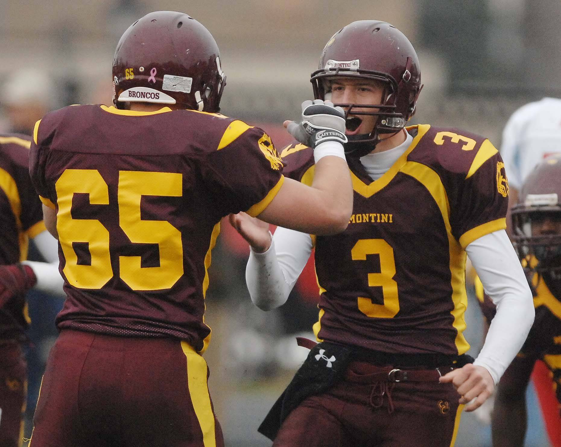 Brian Piper of Montini, left, and Matt Westerkamp of Montini celebrate as they take the lead during Saturday's game against Marian Central.