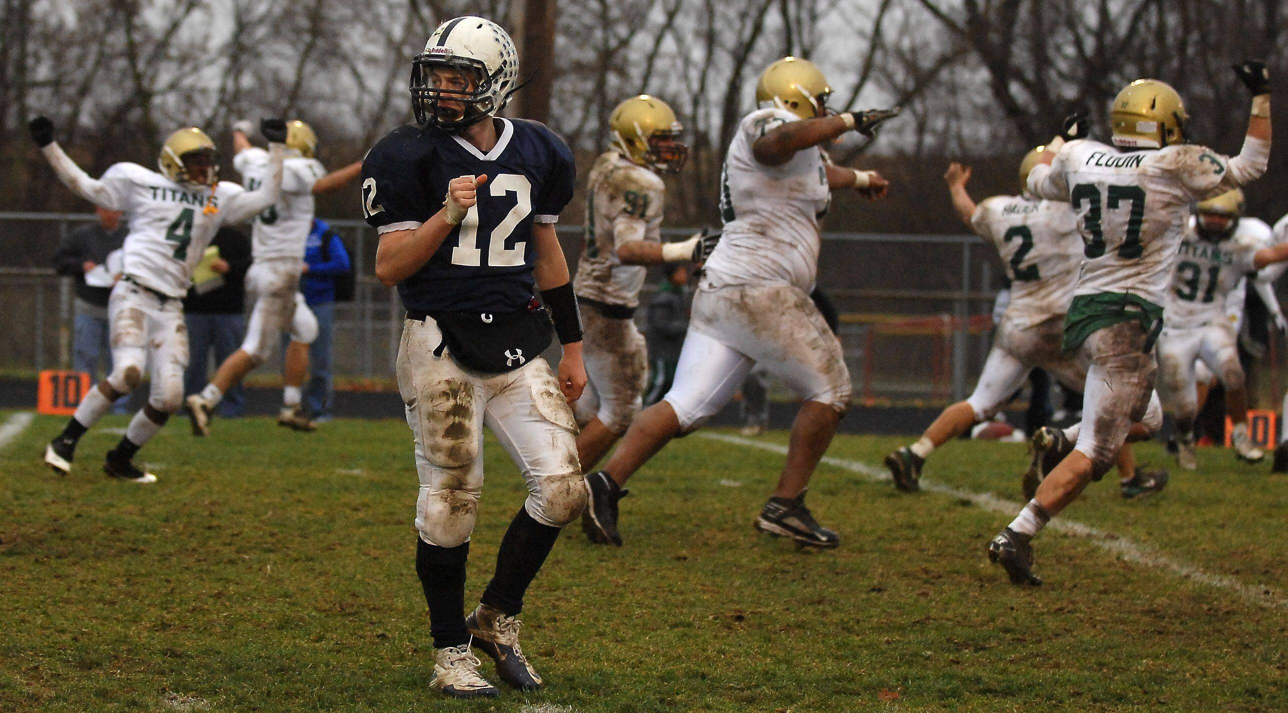 Cary-Grove quarterback Corey Laktas looks at the end zone after his 4th down pass in overtime fell incomplete to give the win to Rockford Boylan during Saturday's playoff game in Cary.