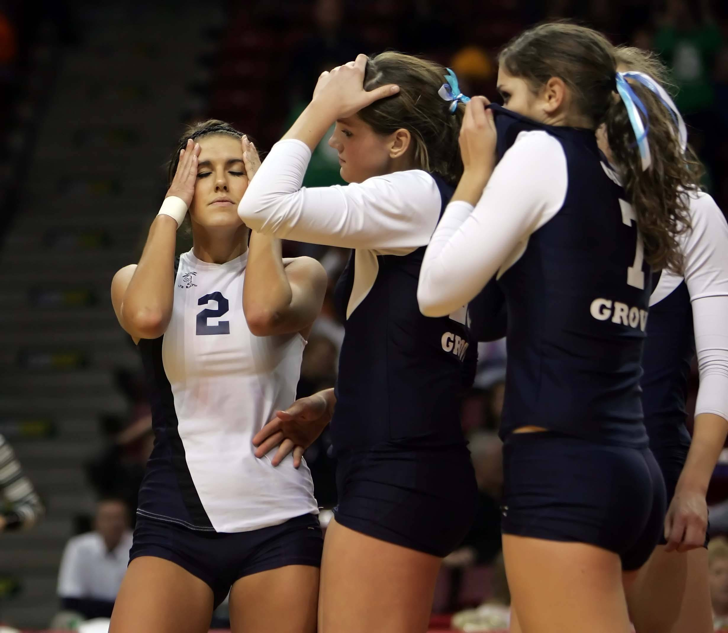 Cary-Grove libero Sam Mainzer, 2, reacts with her teammates after their loss to Lyons.