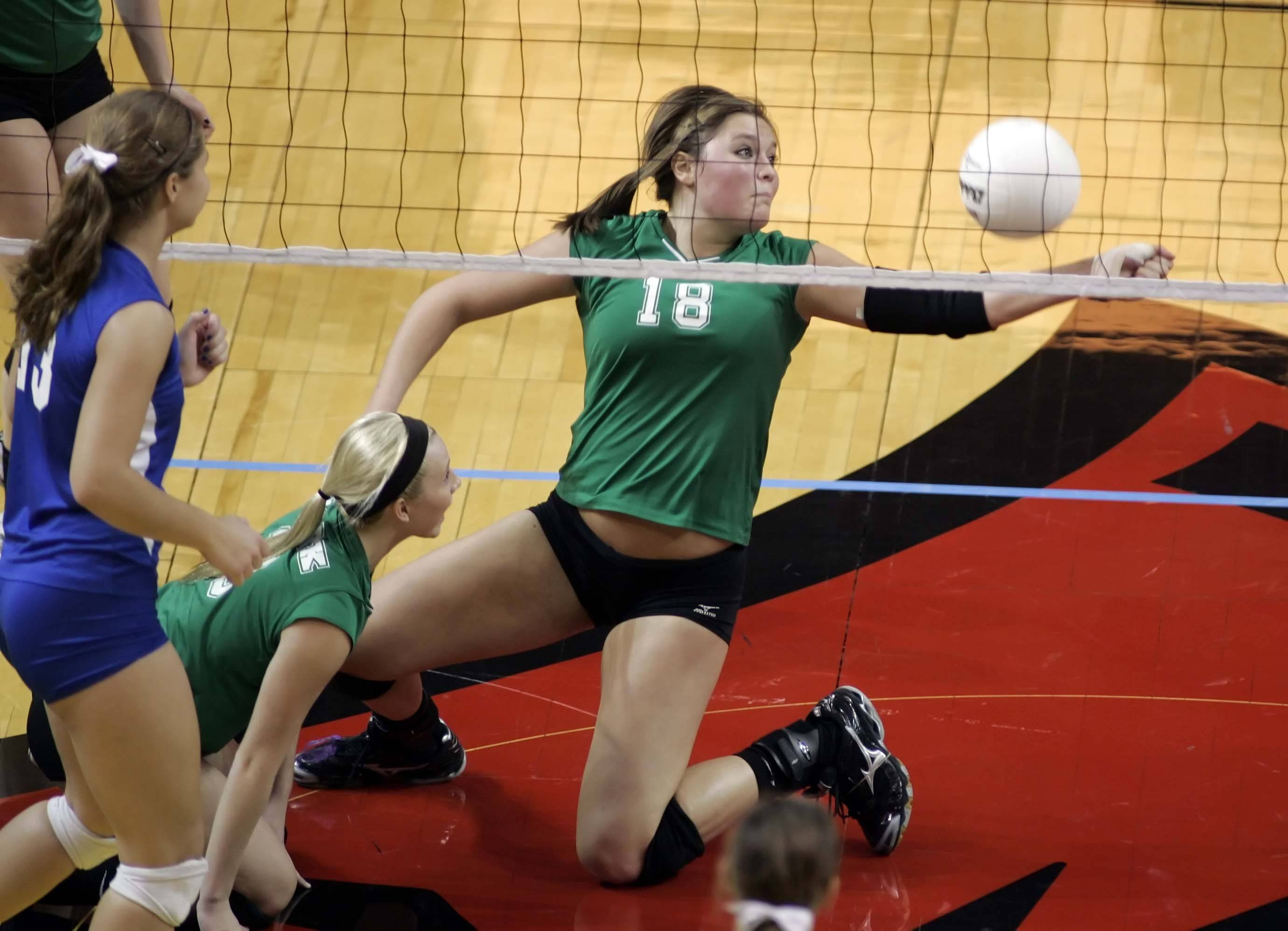 York middle blocker Sam Schrenker, 18, tries to pick up a dig during their match against Lyons in the IHSA Class 4A State semi-final match Friday.