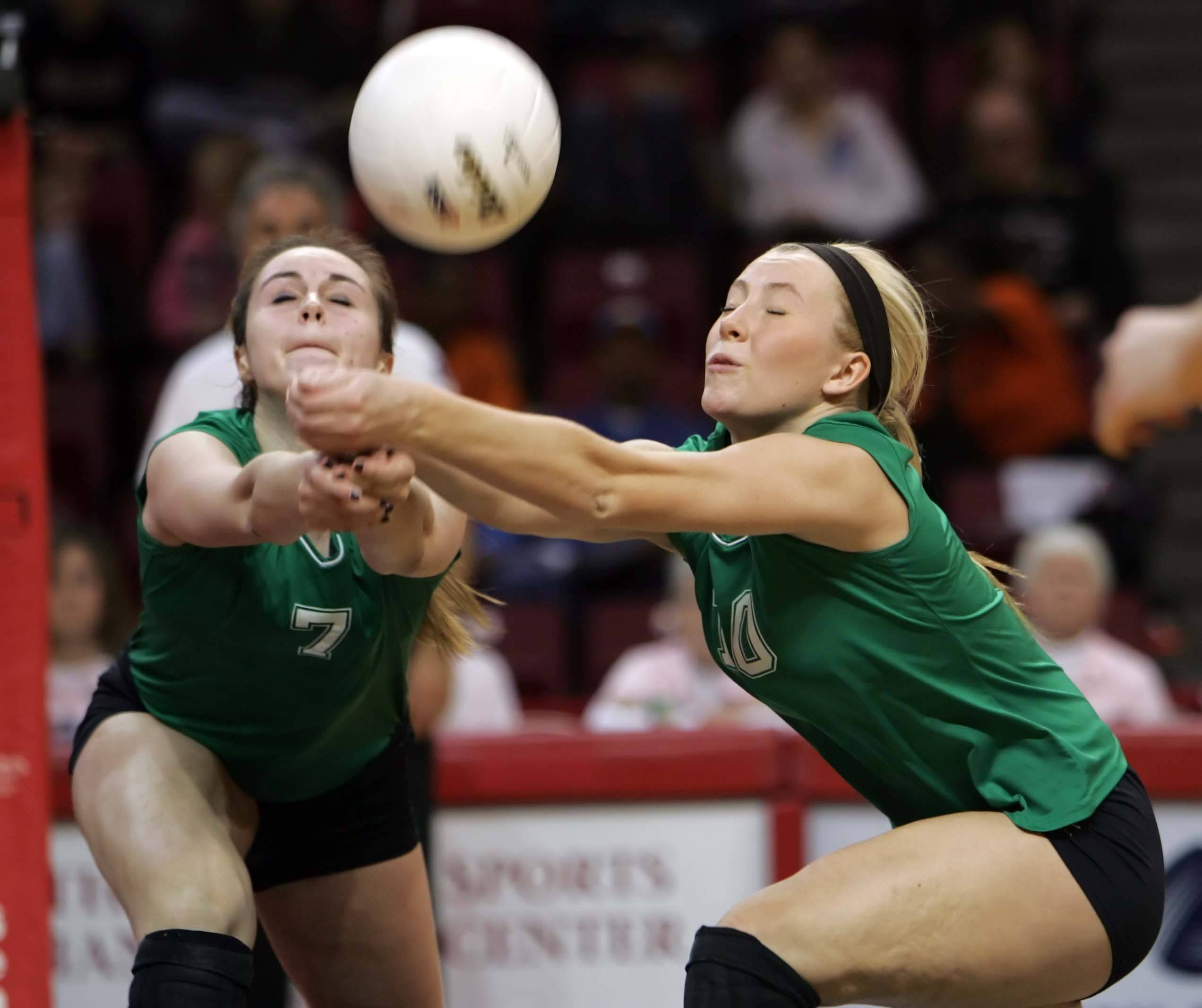 York's Emily Iverson, 7, and Katie Gallagher, 10, try to pick up a dig Friday during their state match against Lyons.