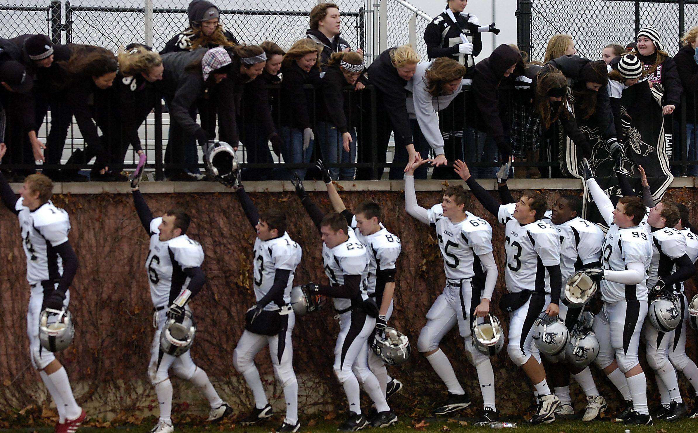 Kaneland celebrates with their fans at the end of the game after defeating Vernon Hill in the Class 5A quarter finals Saturday.