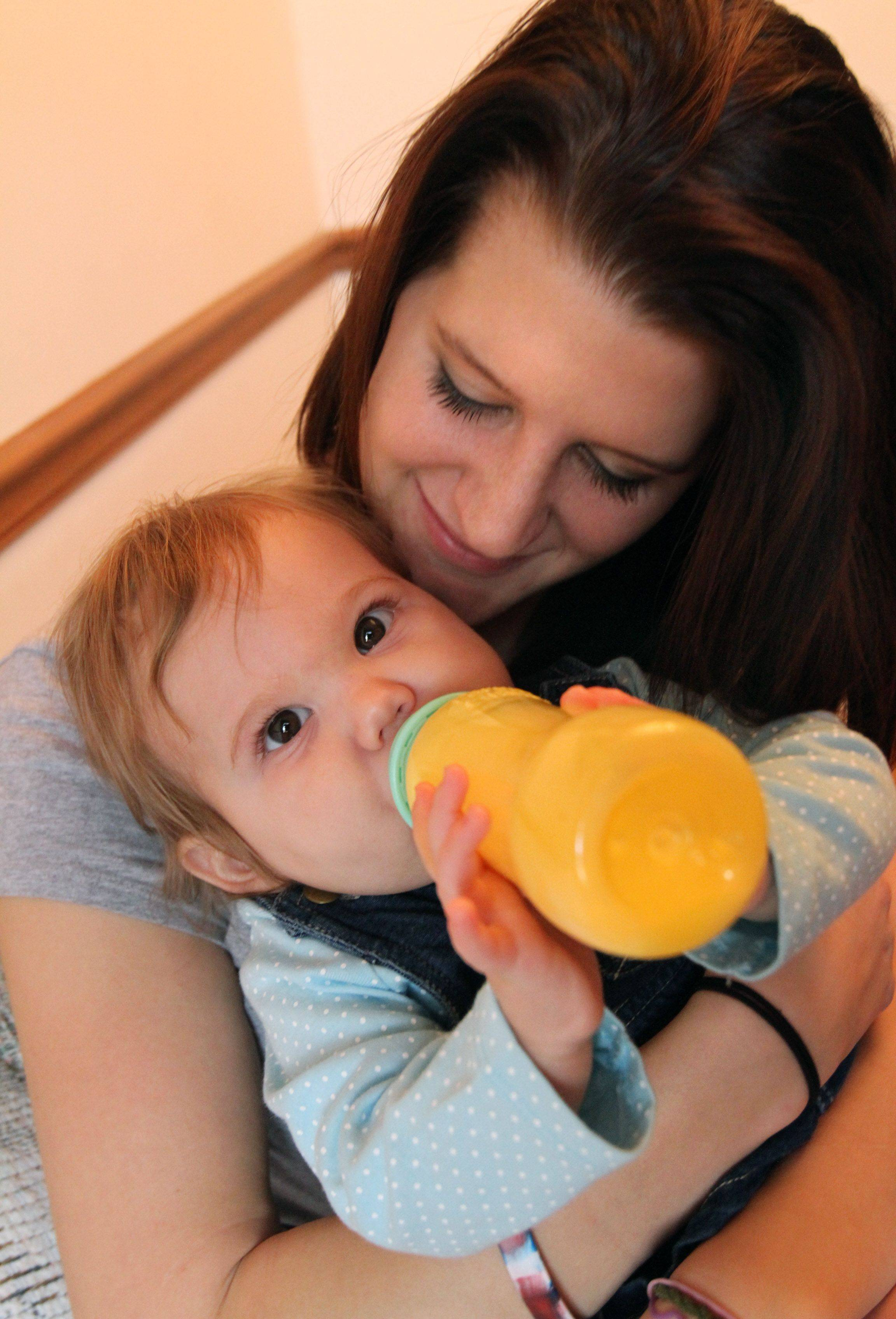 Katie Stack holds her one-year-old daughter Mikayla at the home of Katie's mother, Dawn Hedrick, in Arlington Heights.