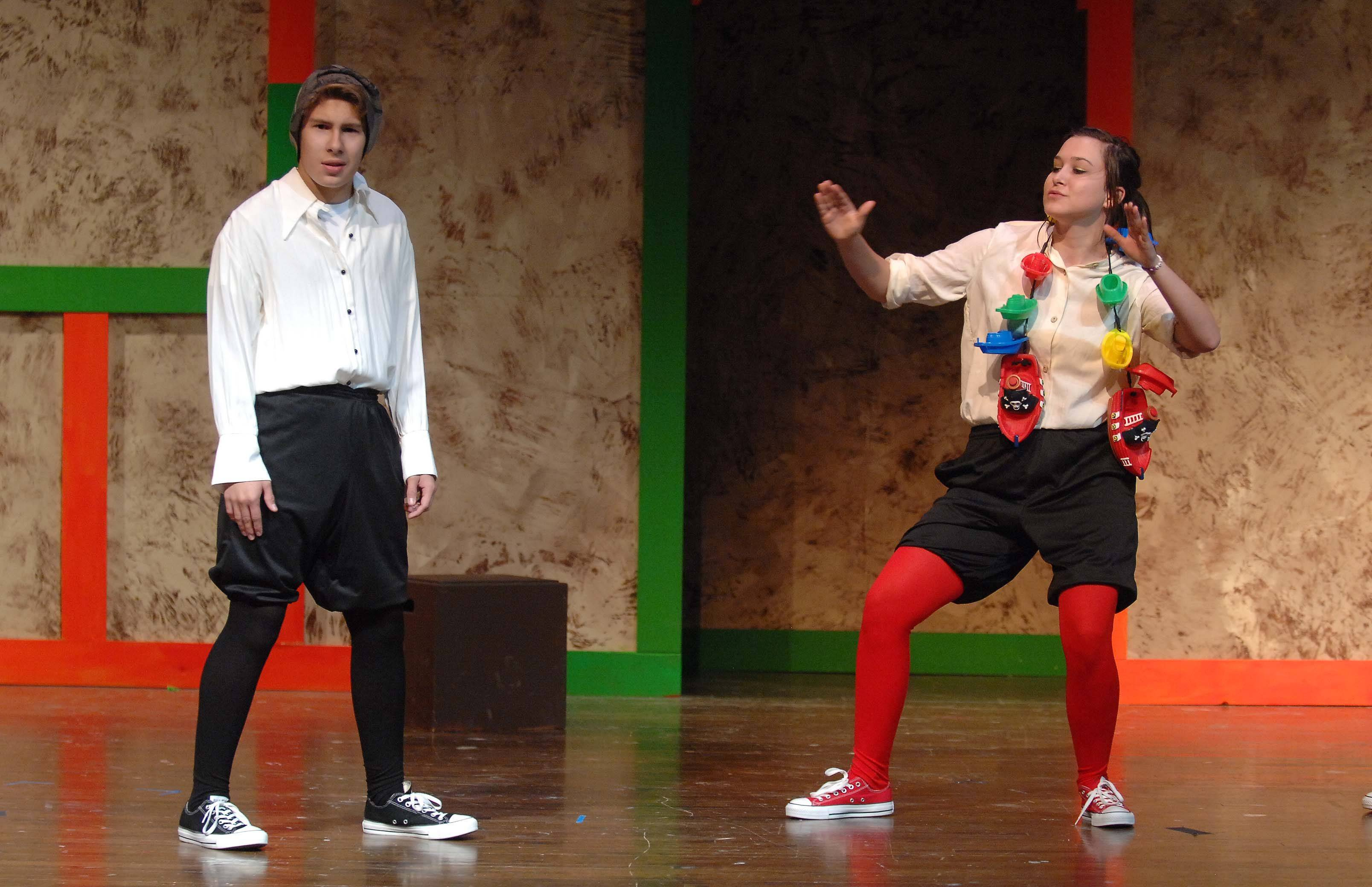 "Aaron Morden, left, and Elena Tubridy help deliver a fast-paced, comedic rendition of all the Bard's tales in Community High School's ""The Complete Works of William Shakespeare (Abridged)."""