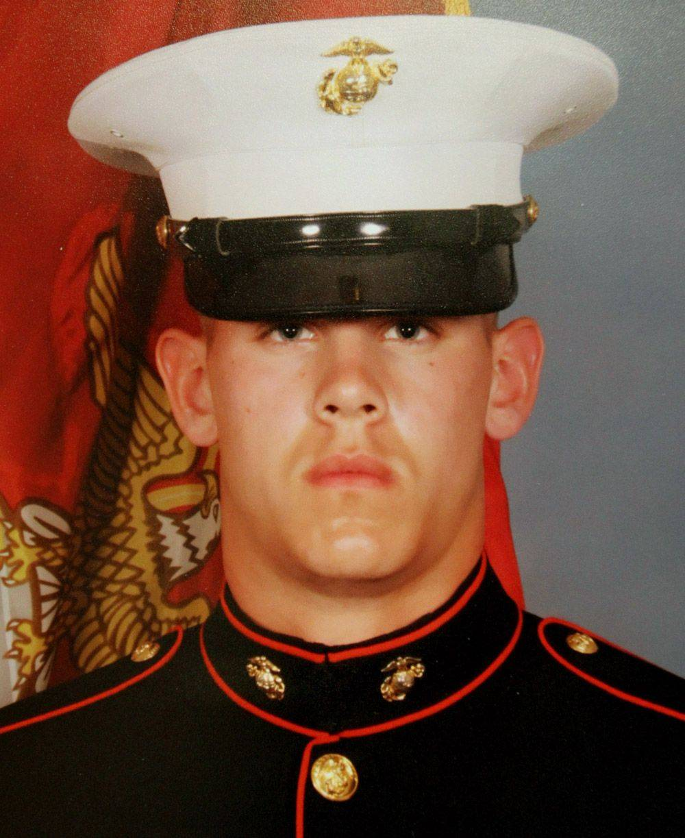 Hundreds pay respects as fallen Marine returns home