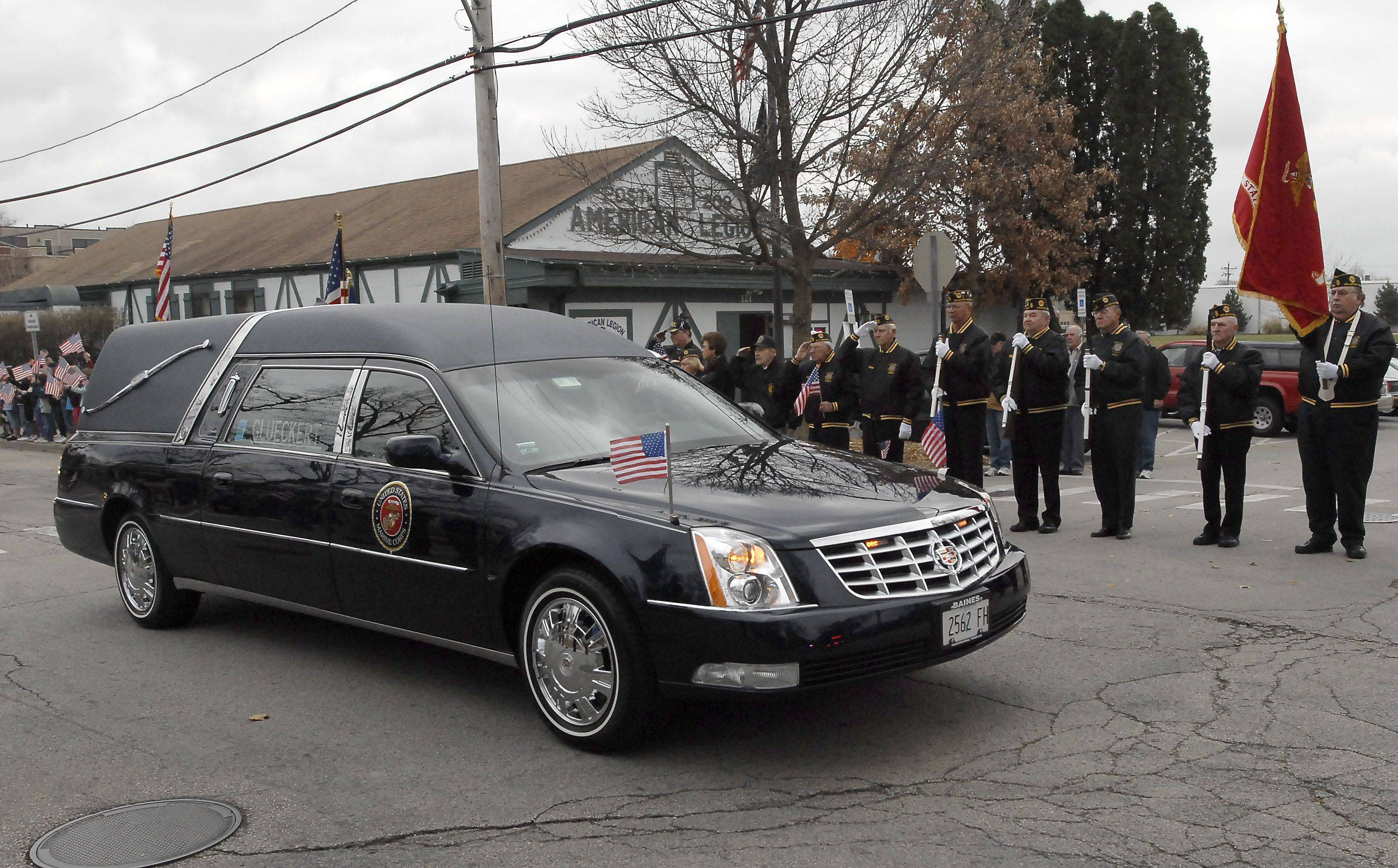 The hearse with Marine James Bray Stack passes American Legion Post 208 Thursday on Miner Street in Arlington Heights.